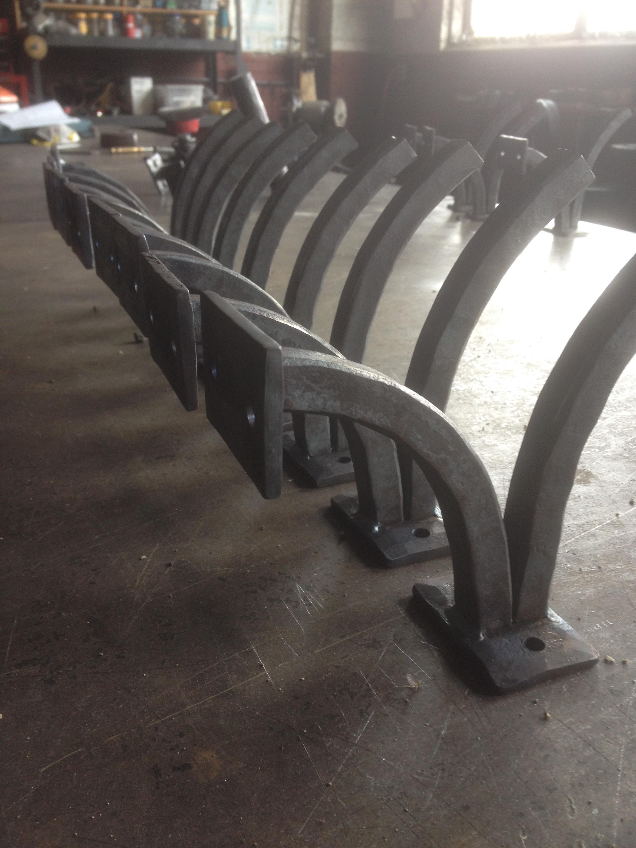 Hand forged brackets for a bar rail