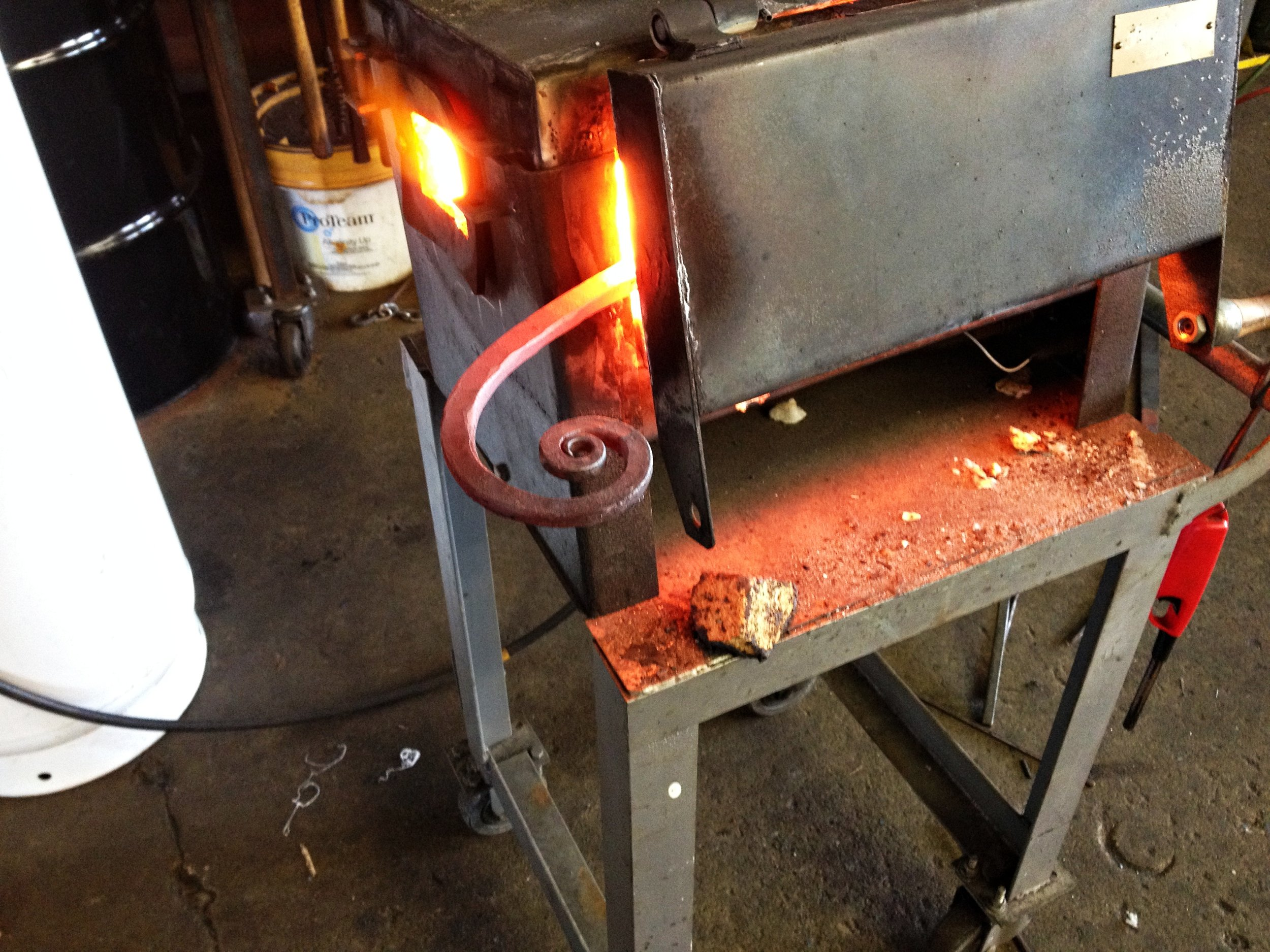 Forging a scroll for a hand rail