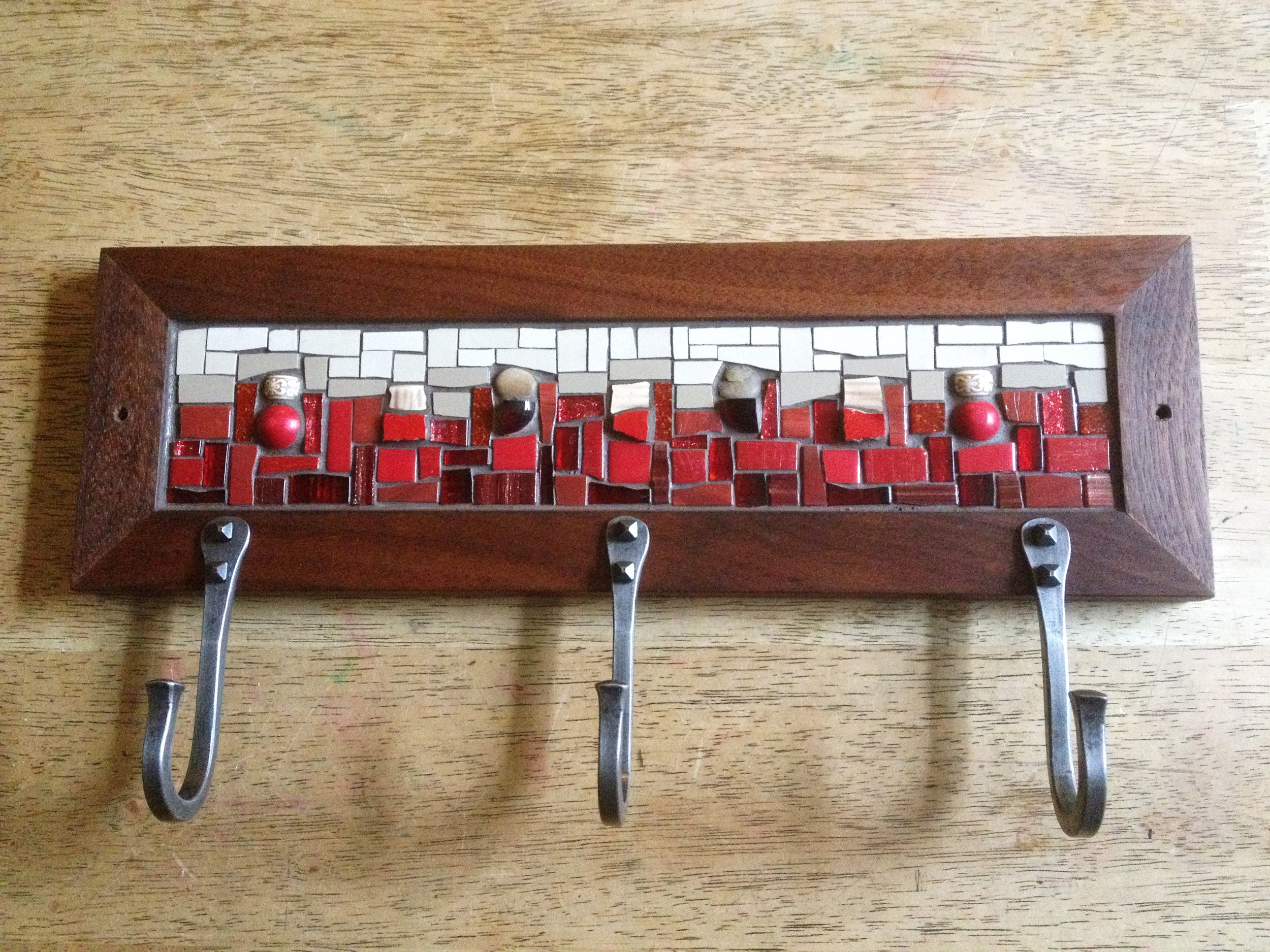 This red and tan piece was a special request for a coat rack with three hooks.