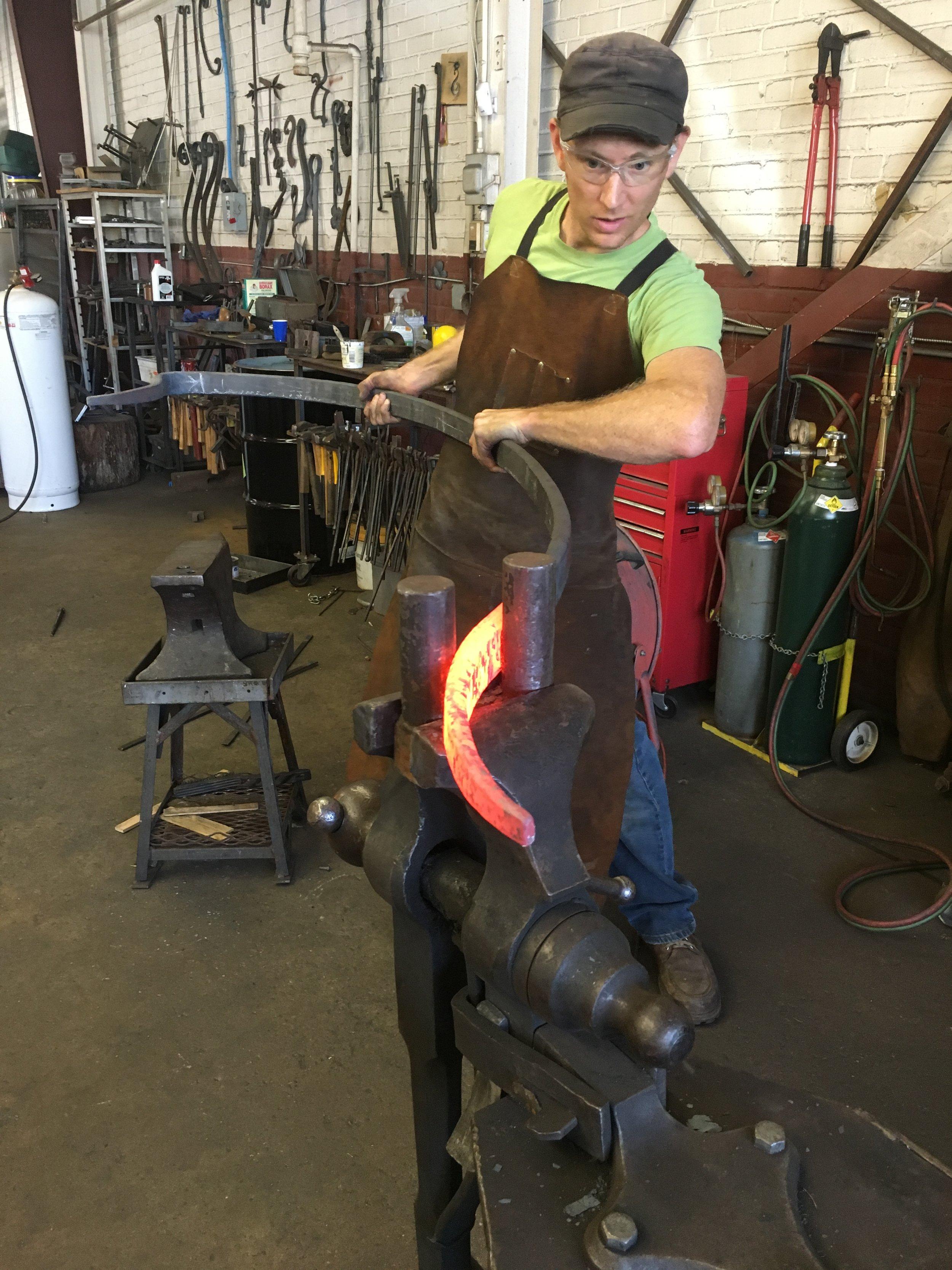 Kyle forging a porch hand rail