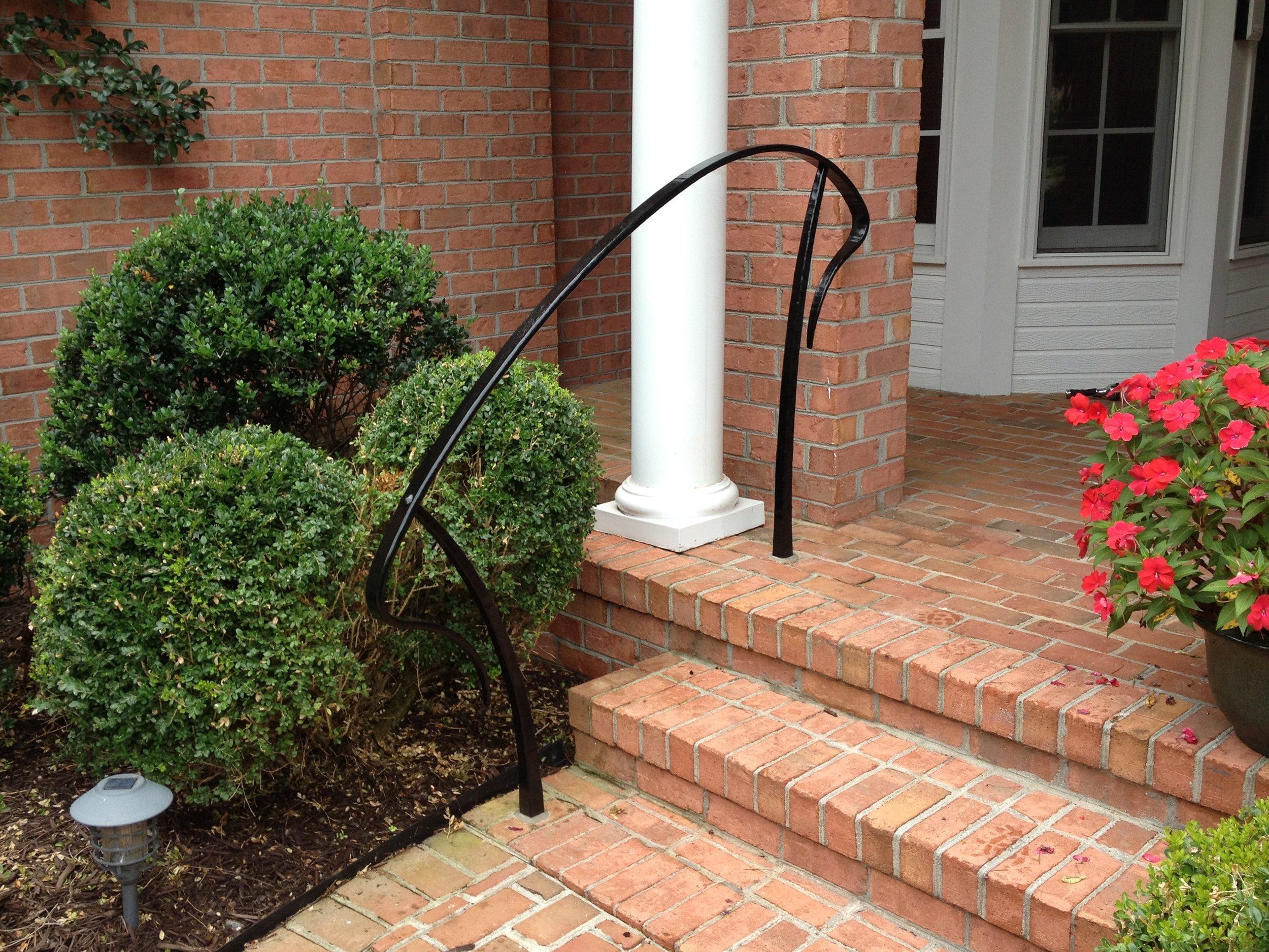 Hand-forged nouveau porch stair rail.