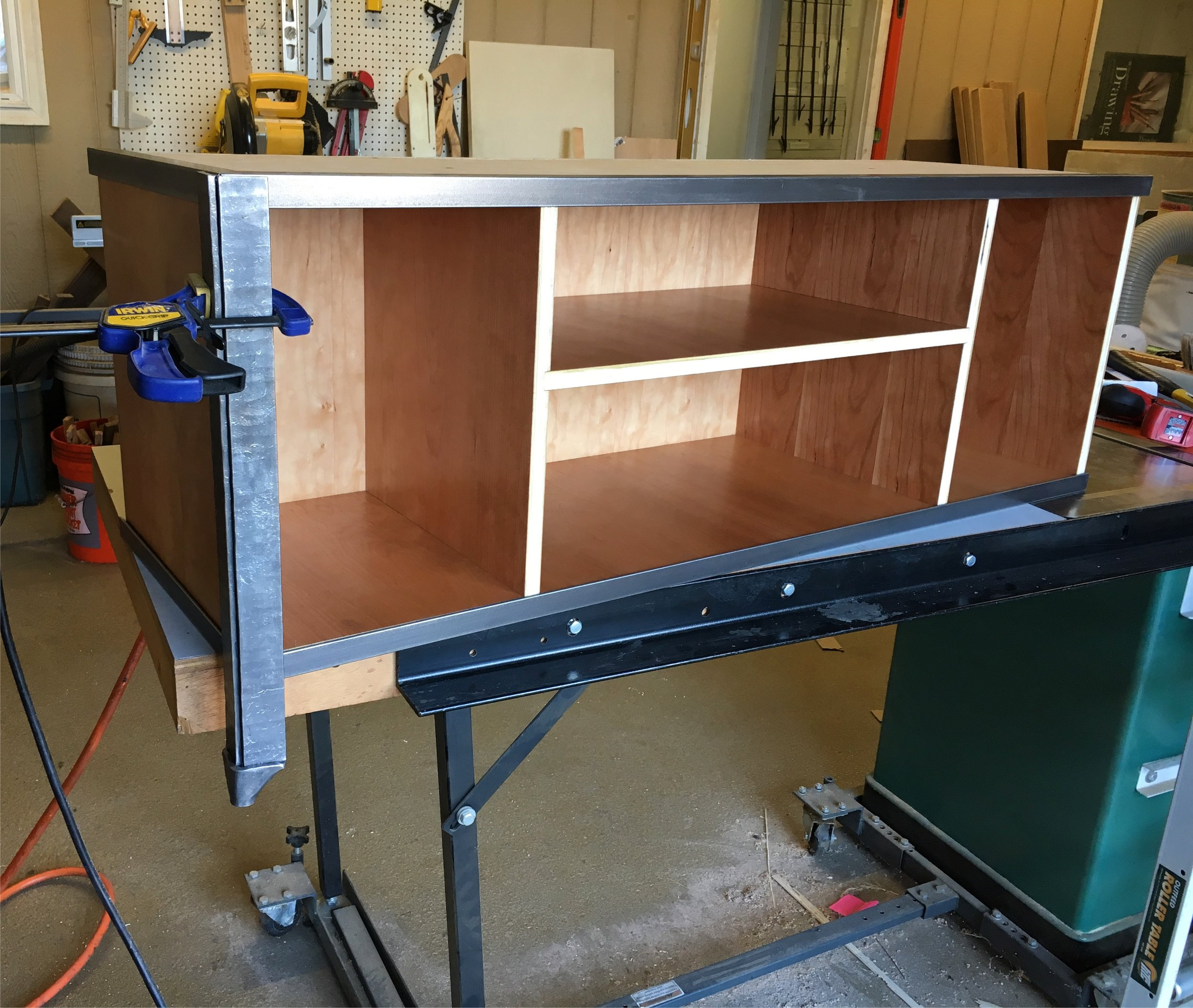 Cherry and forged steel media console in process PH2016