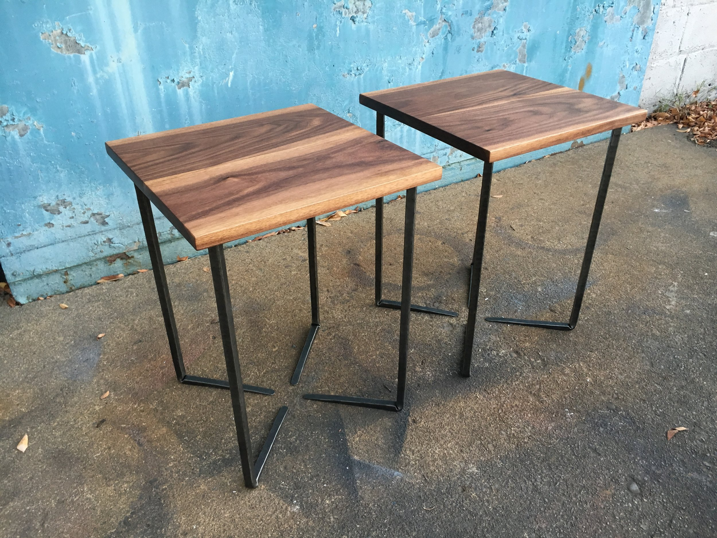 End tables with walnut tops and forged solid steel bases