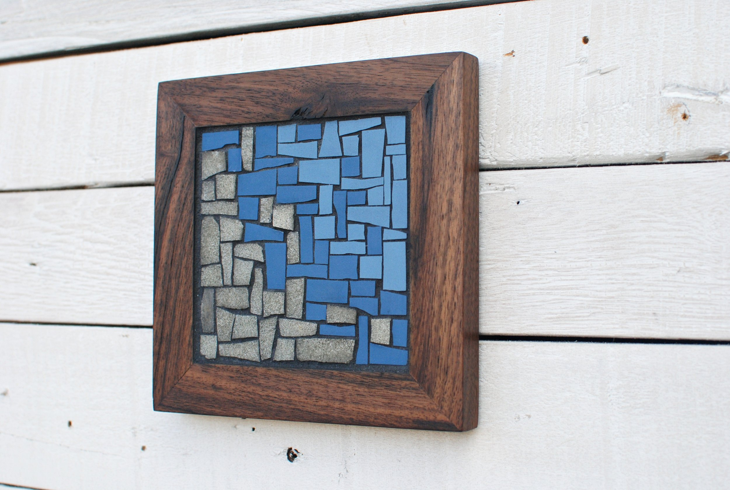 Ocean mosaic trivet on wall