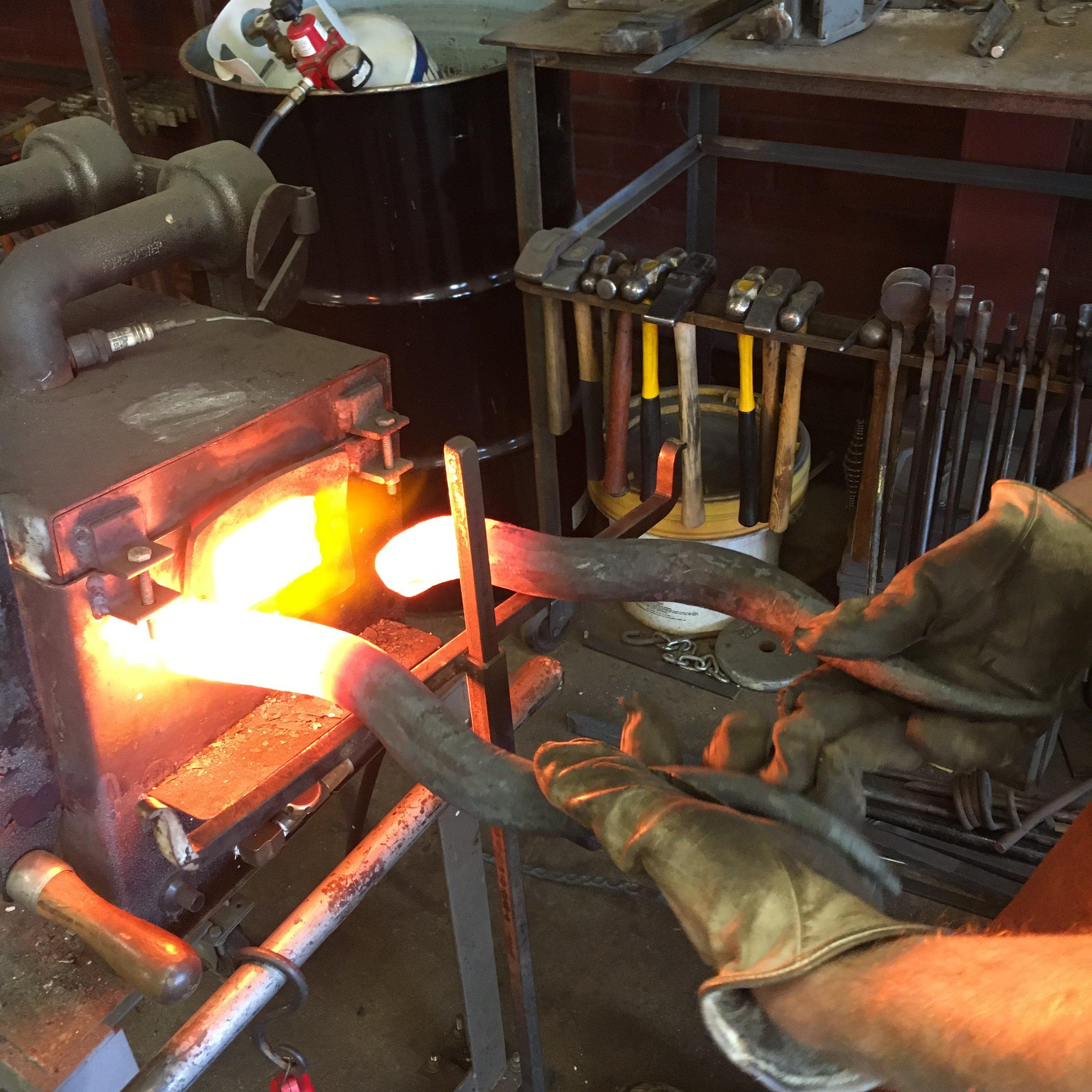 Heating door handles in the gas forge
