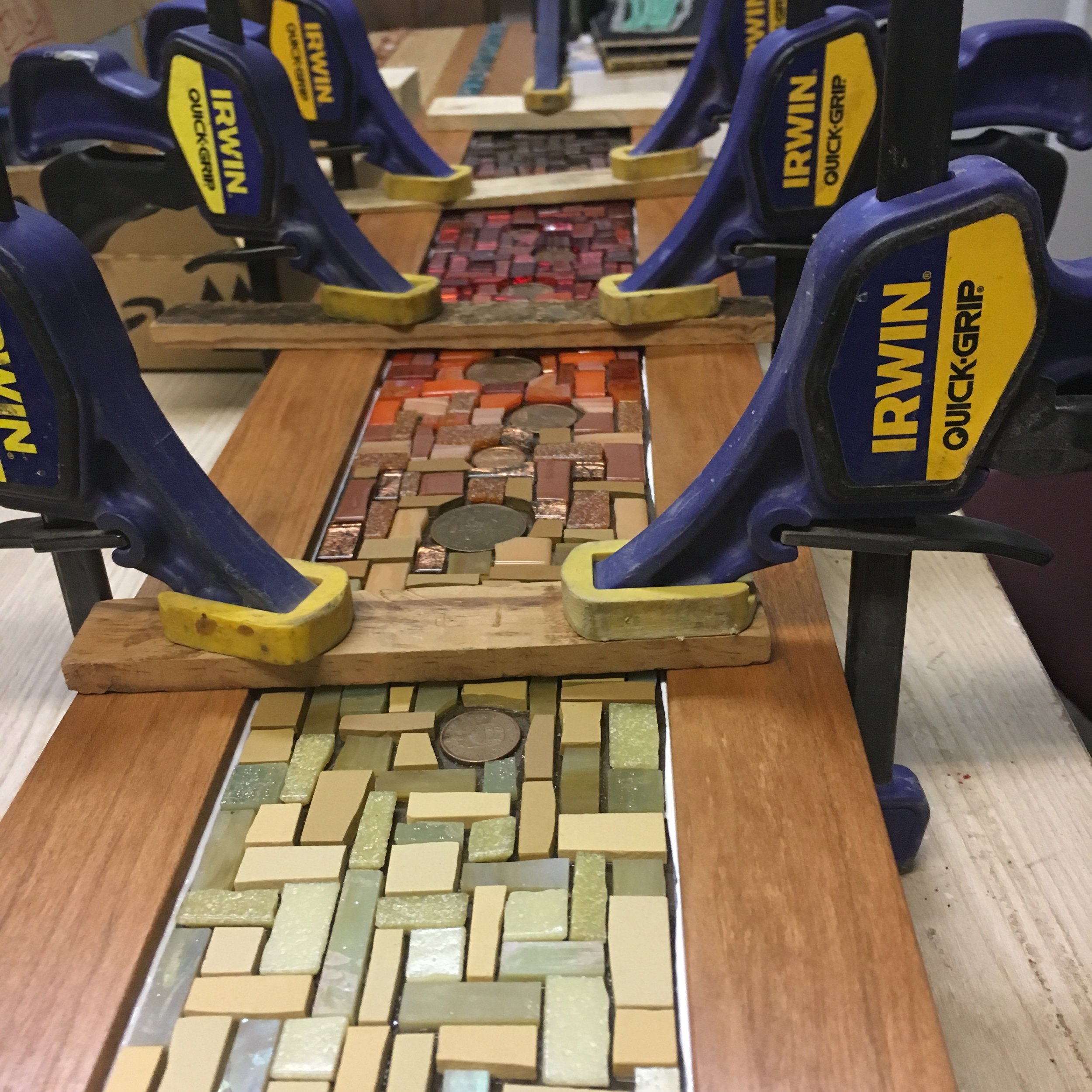 Gluing the mosaic into the frame