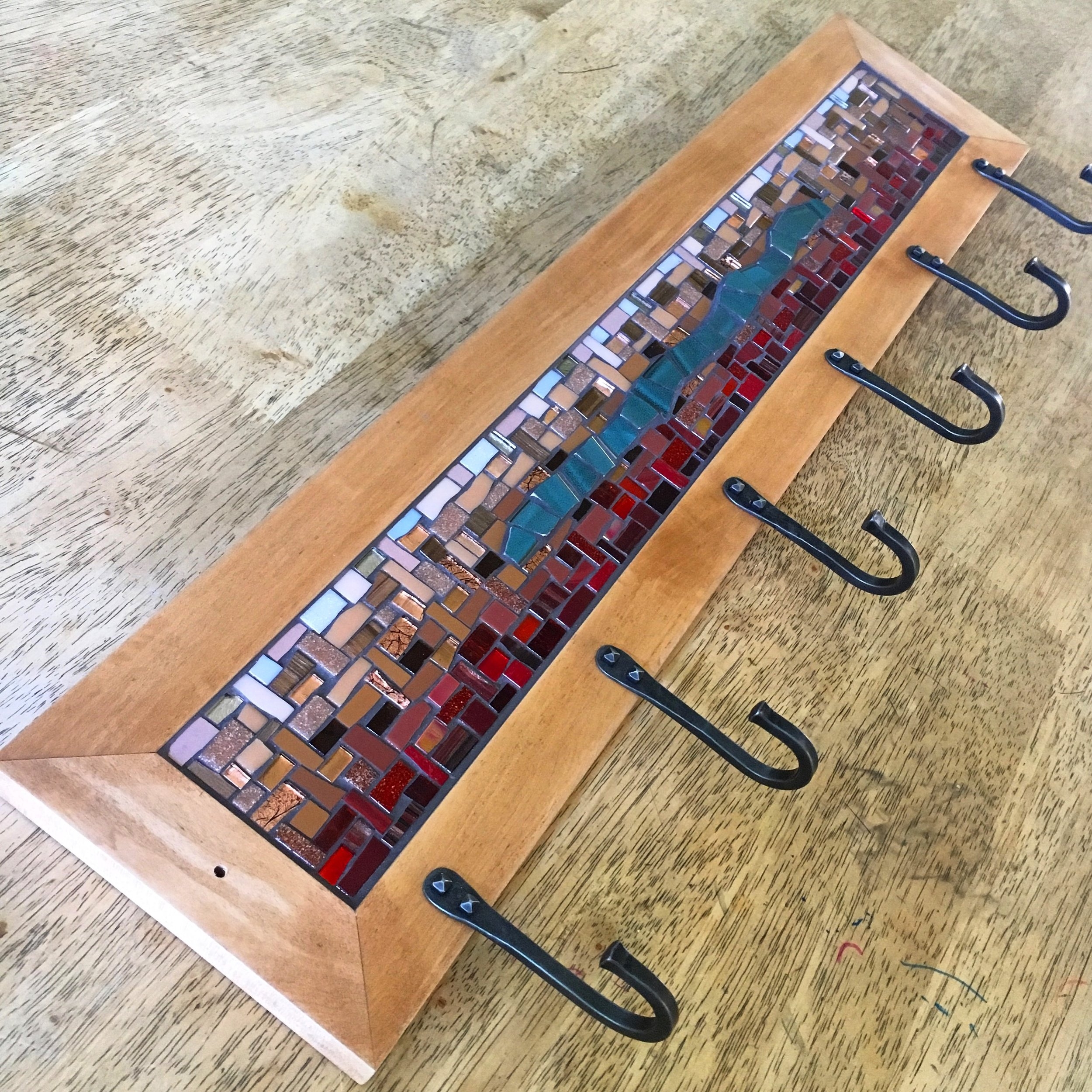 Red and teal mosaic coat rack