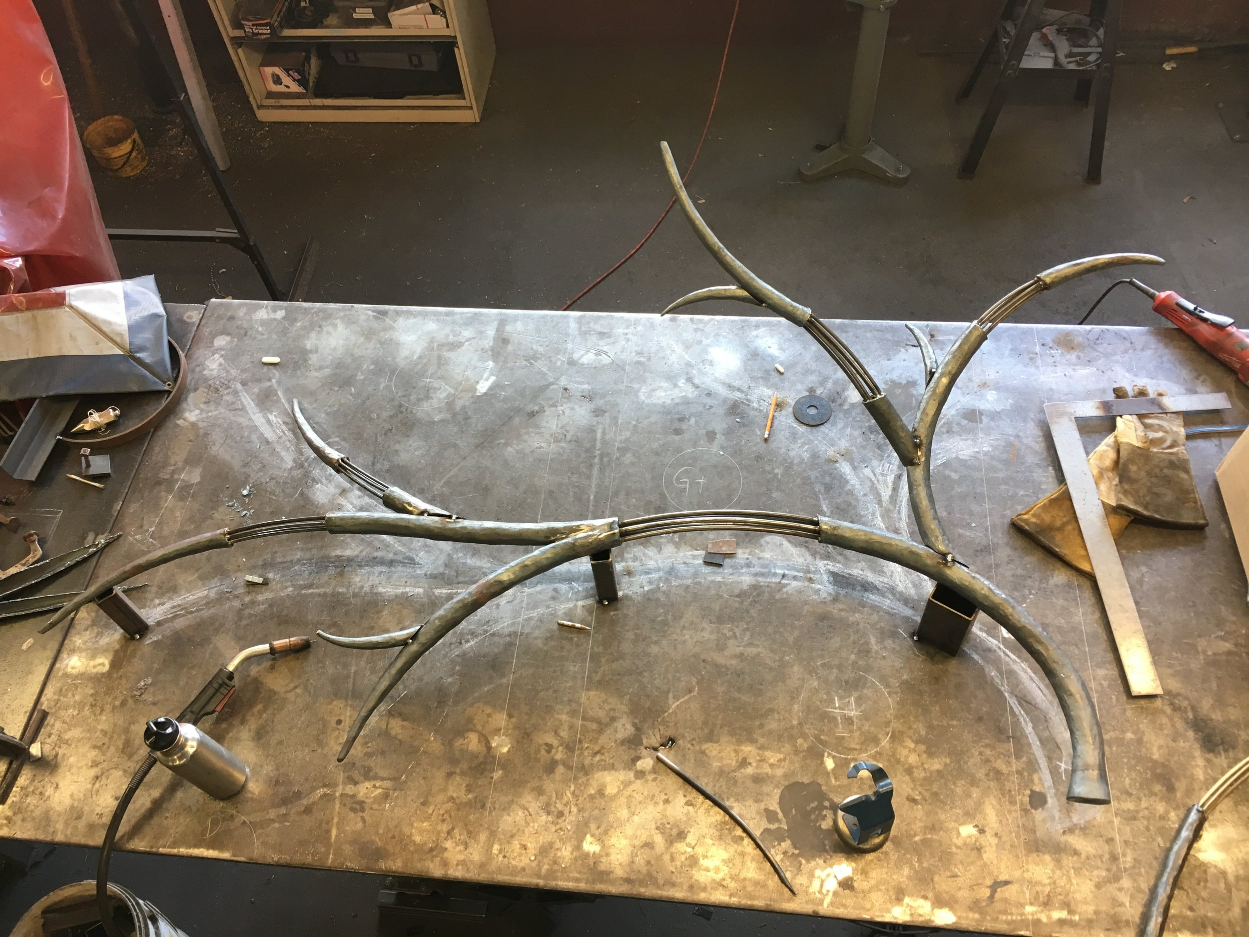 Putting the forged chandelier elements together in the studio
