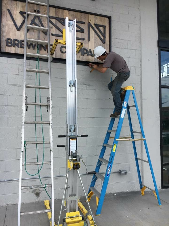 Installing the sign at the Vasen tasting room