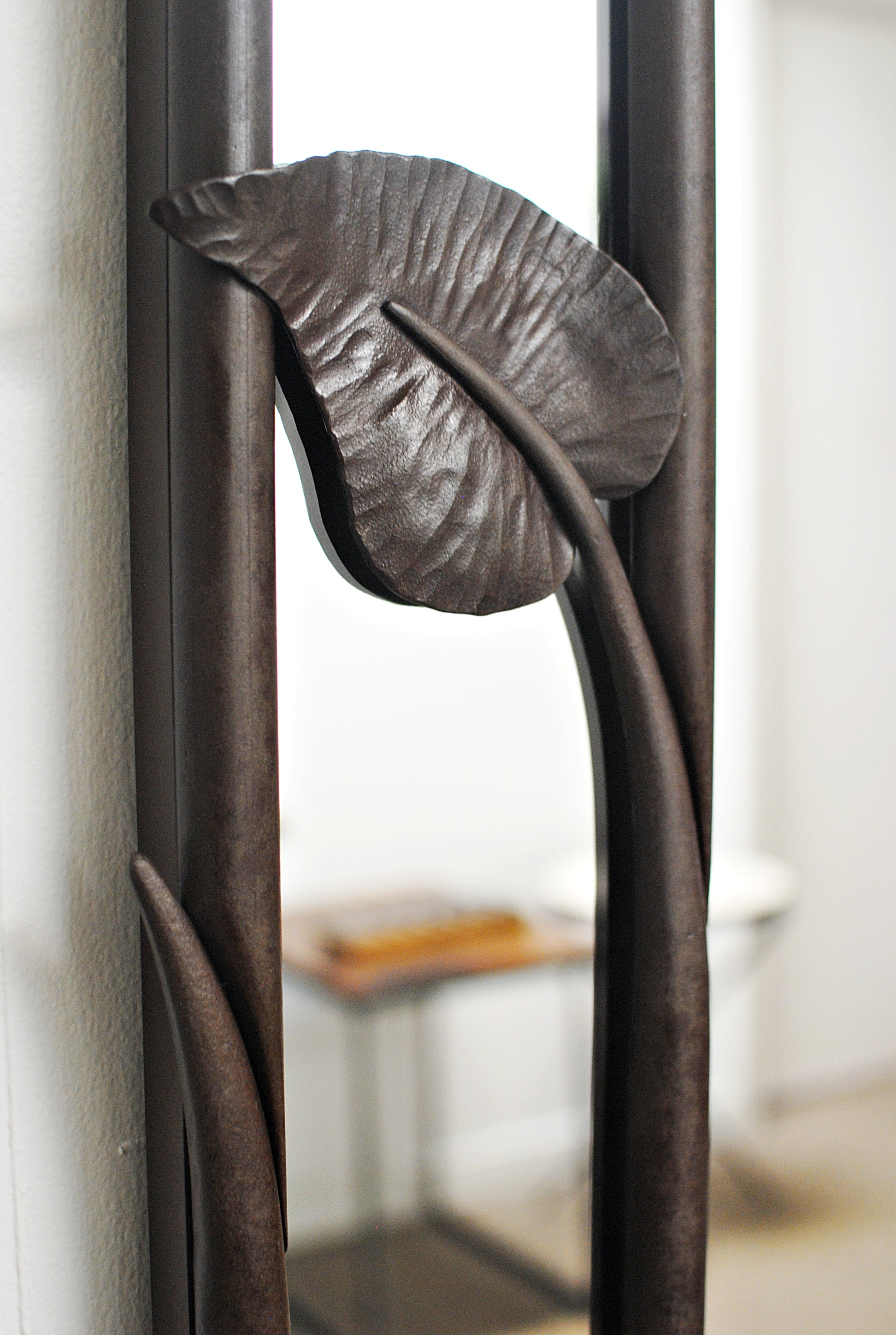 Forged mirror leaf detail