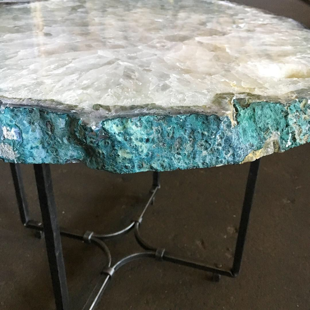 Detail of stone top on forged steel table base