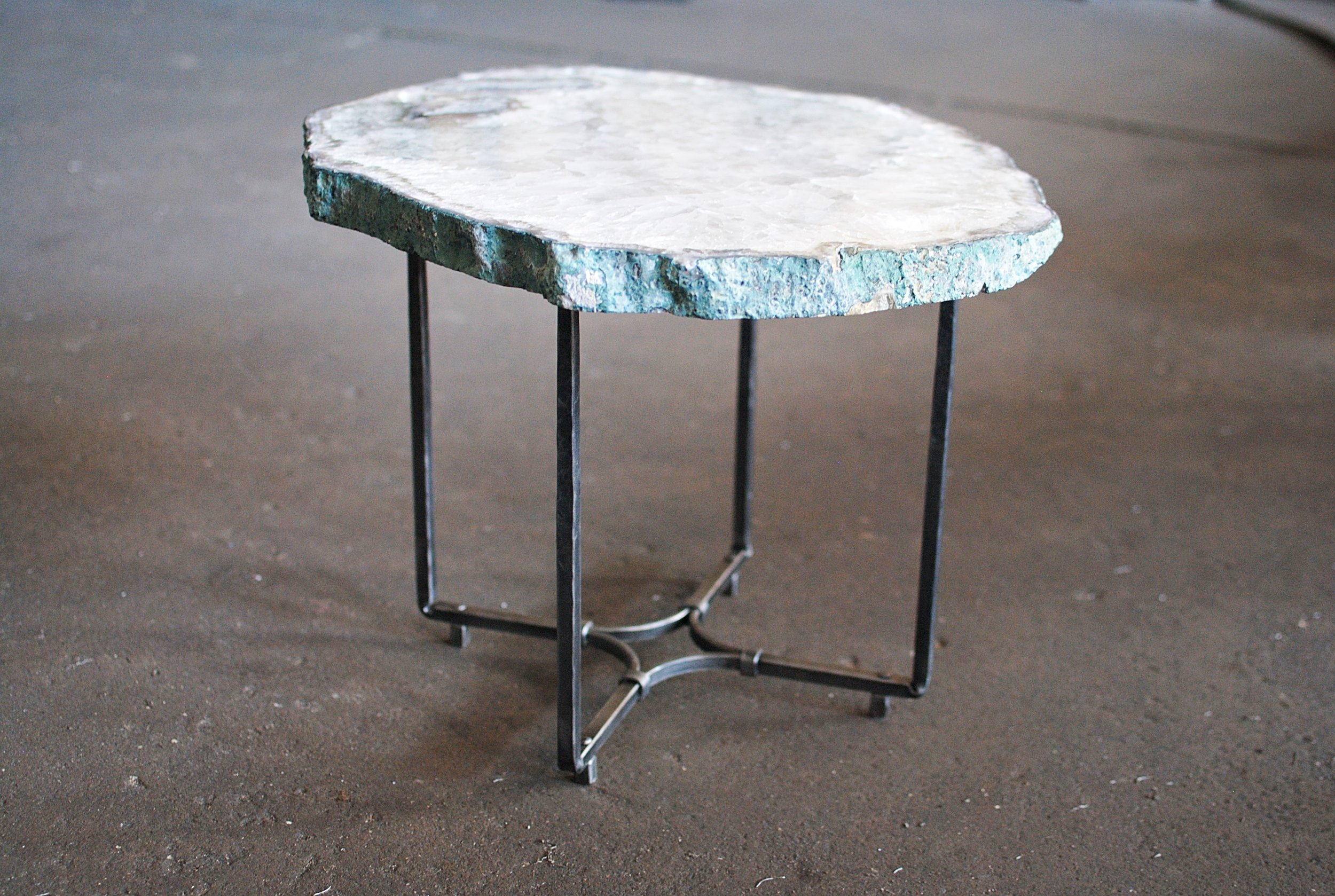 Forged table base with stone top
