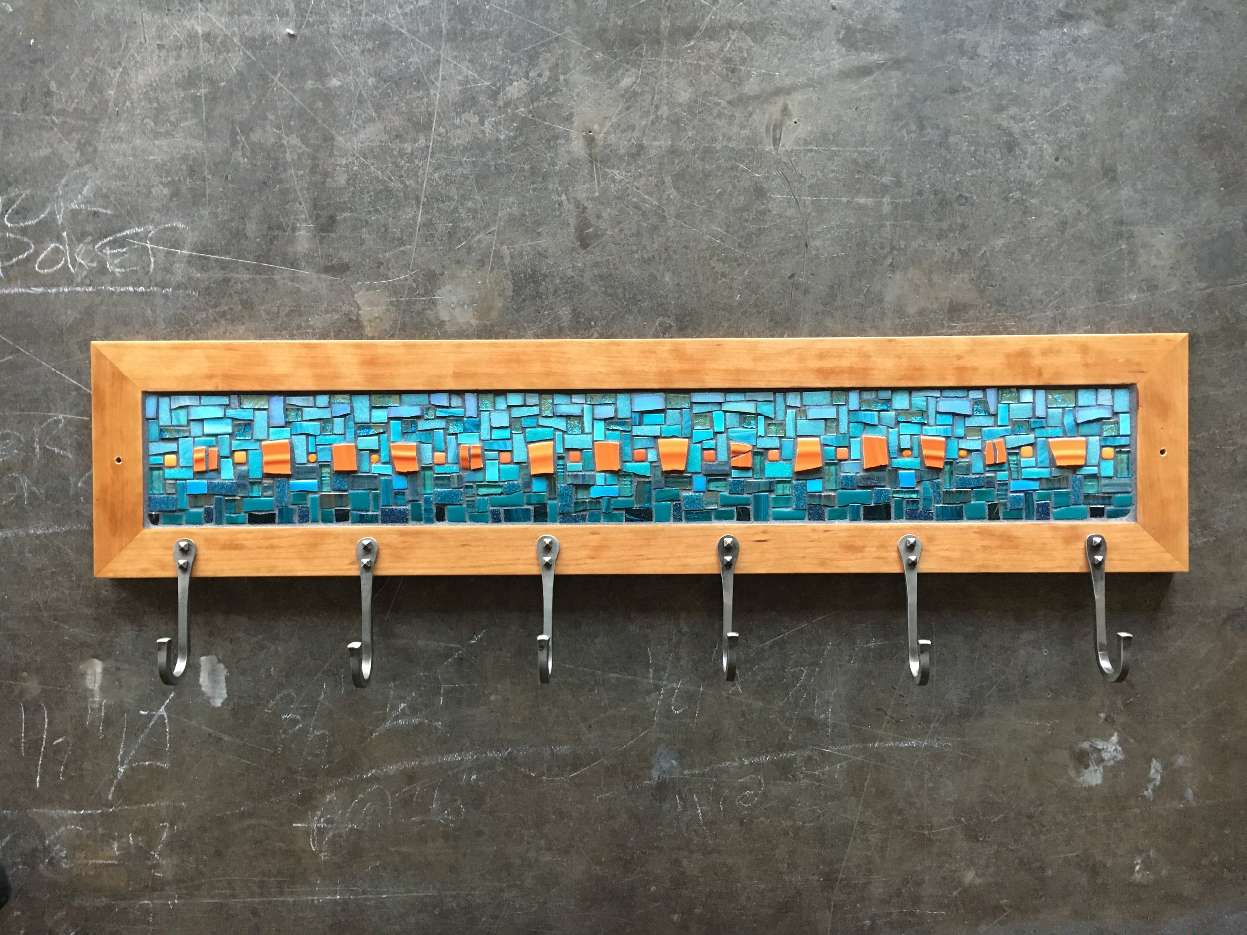 Custom mosaic coat rack in cherry frame with forged steel hooks