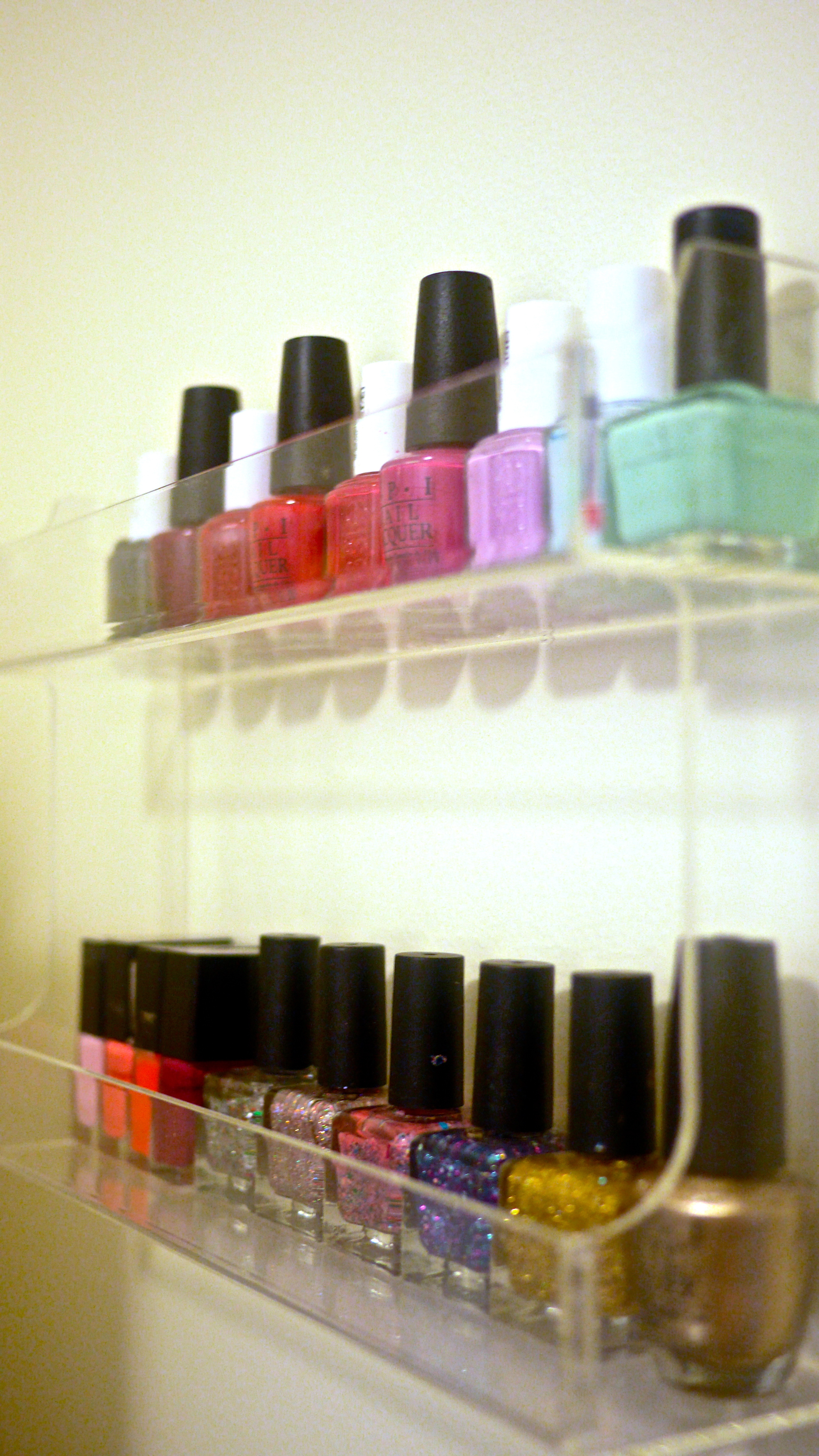 i got a basic spice rack from the container store to make a cute nail polish display case!