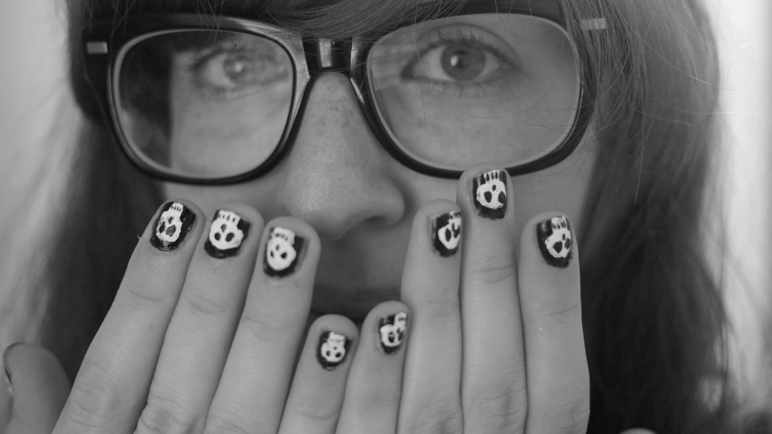 Nate painted these lil skulls on my nails! his new talent is a very exciting discovery for me...!