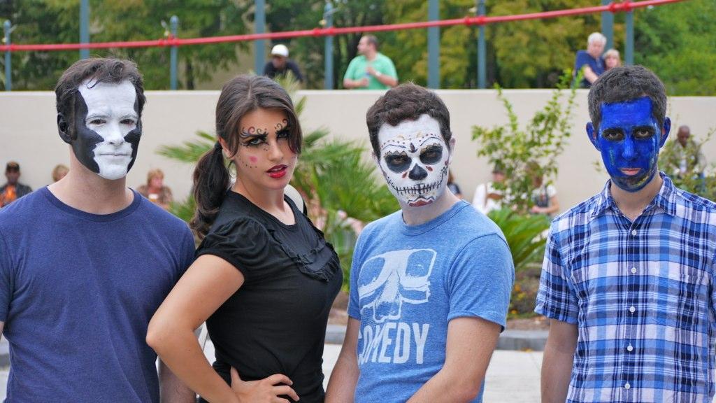 Adam, Juliana, Todd, and Erik in their Halloween costumes.