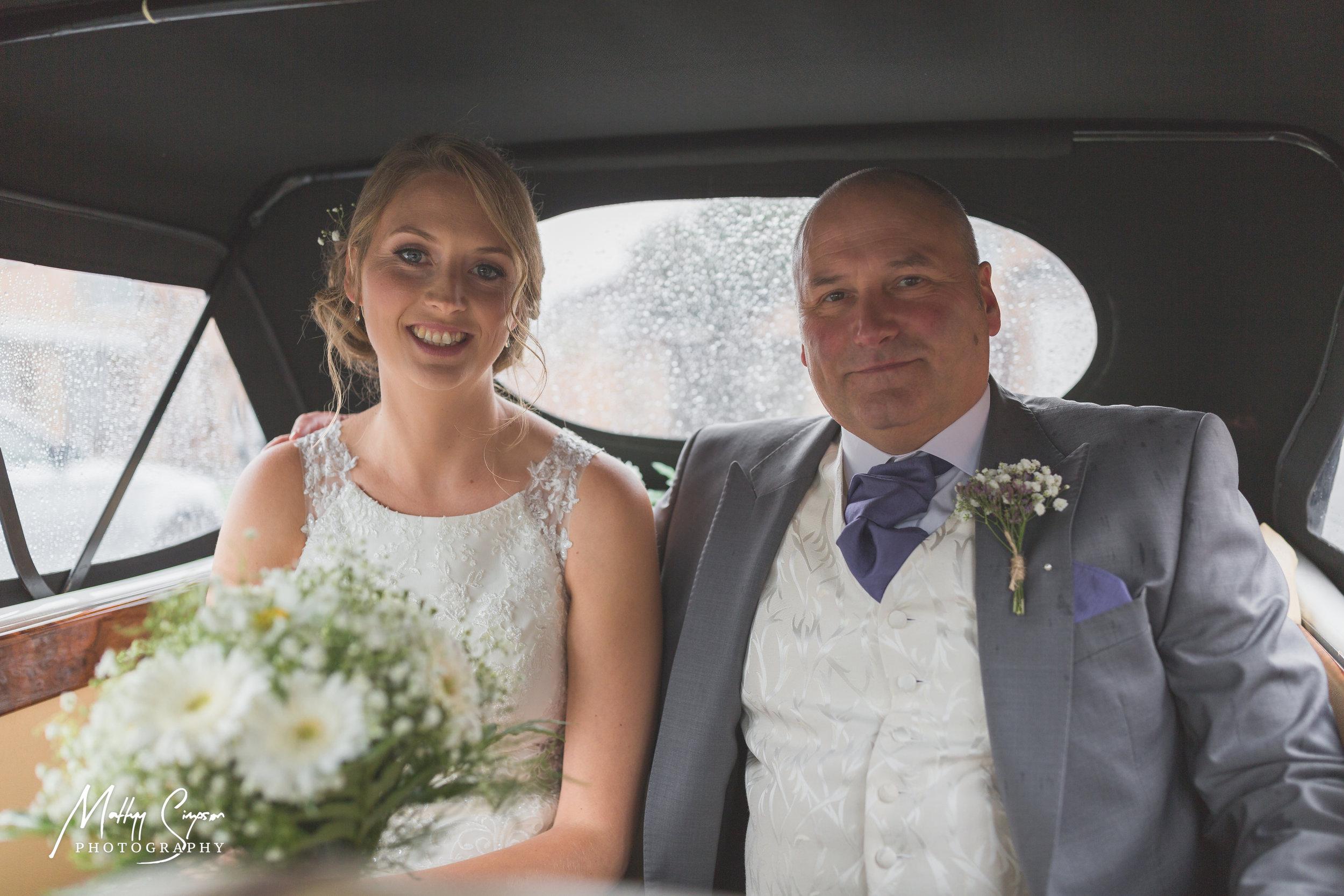 Bride and Father of Bride in Wedding Car