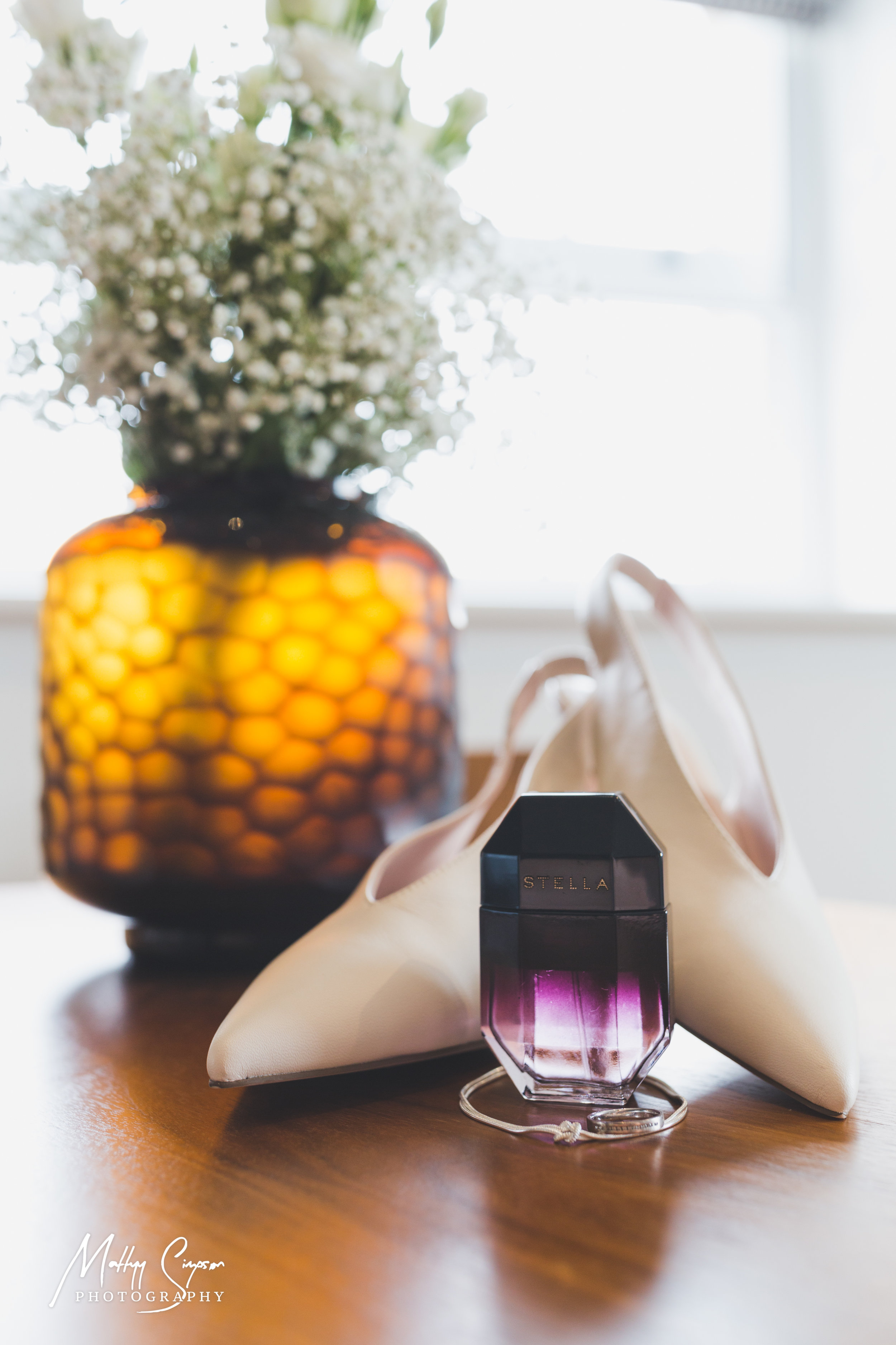 Perfume, wedding shoes, bracelet, engagement ring & flowers