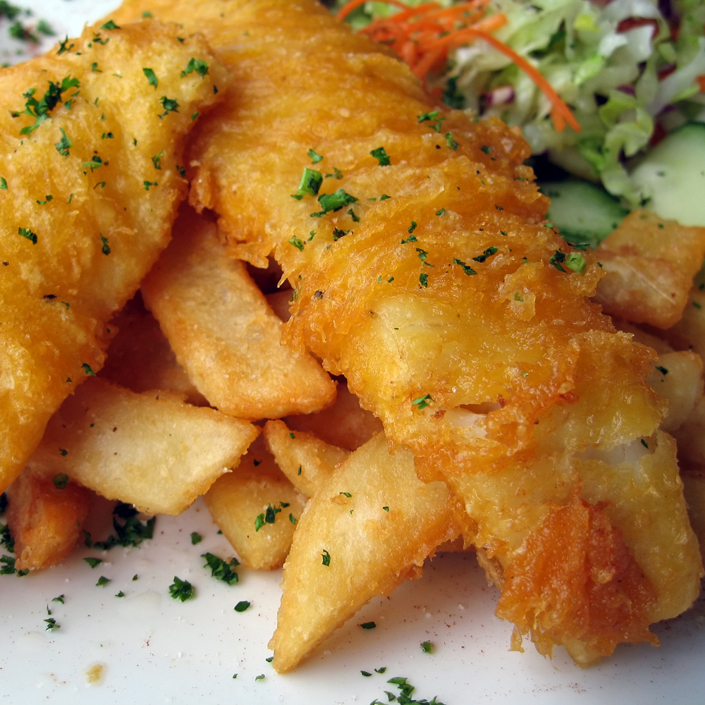 Traditional Fish & Chips Cooked in our own special batter served with chipped potatoes, garden peas, lemon wedge & tartare sauce £9.50