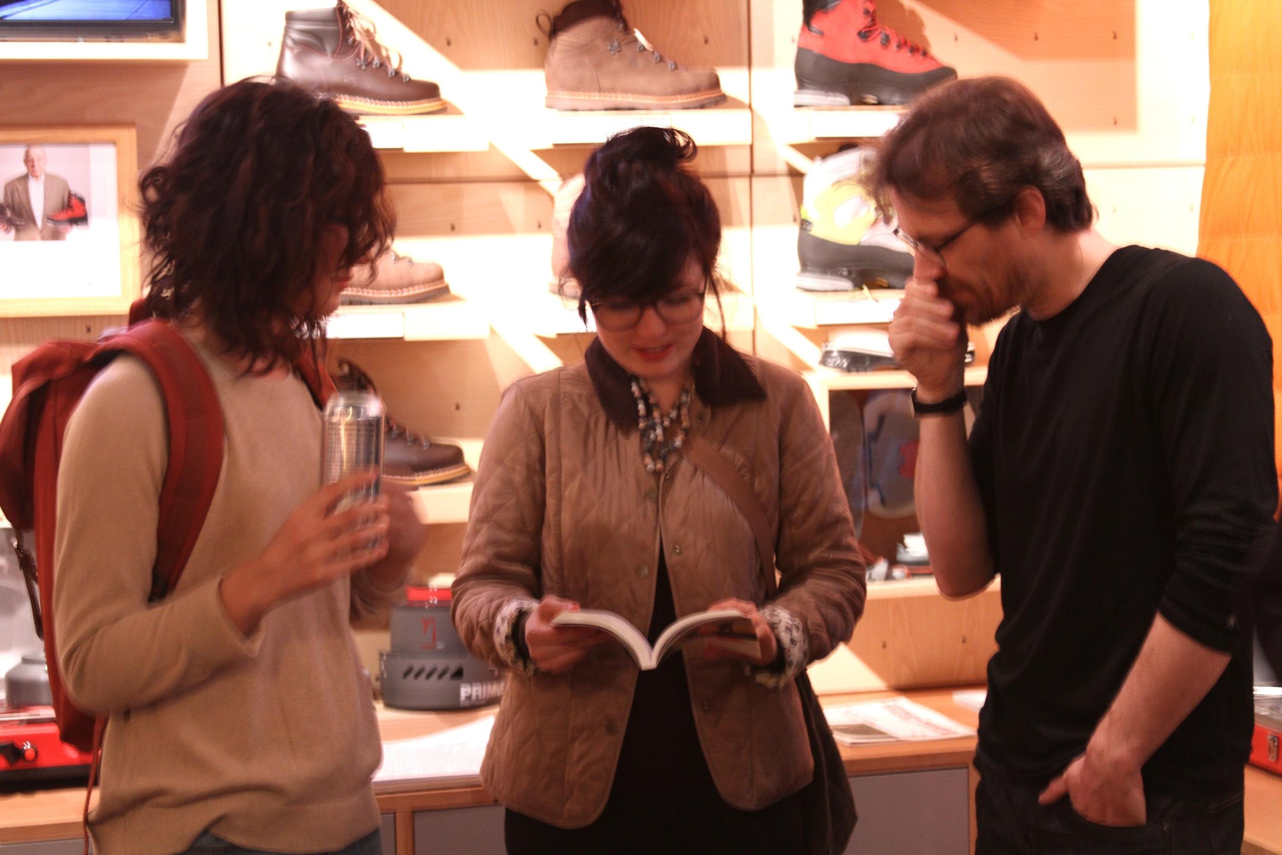 Looking at guide book.JPG
