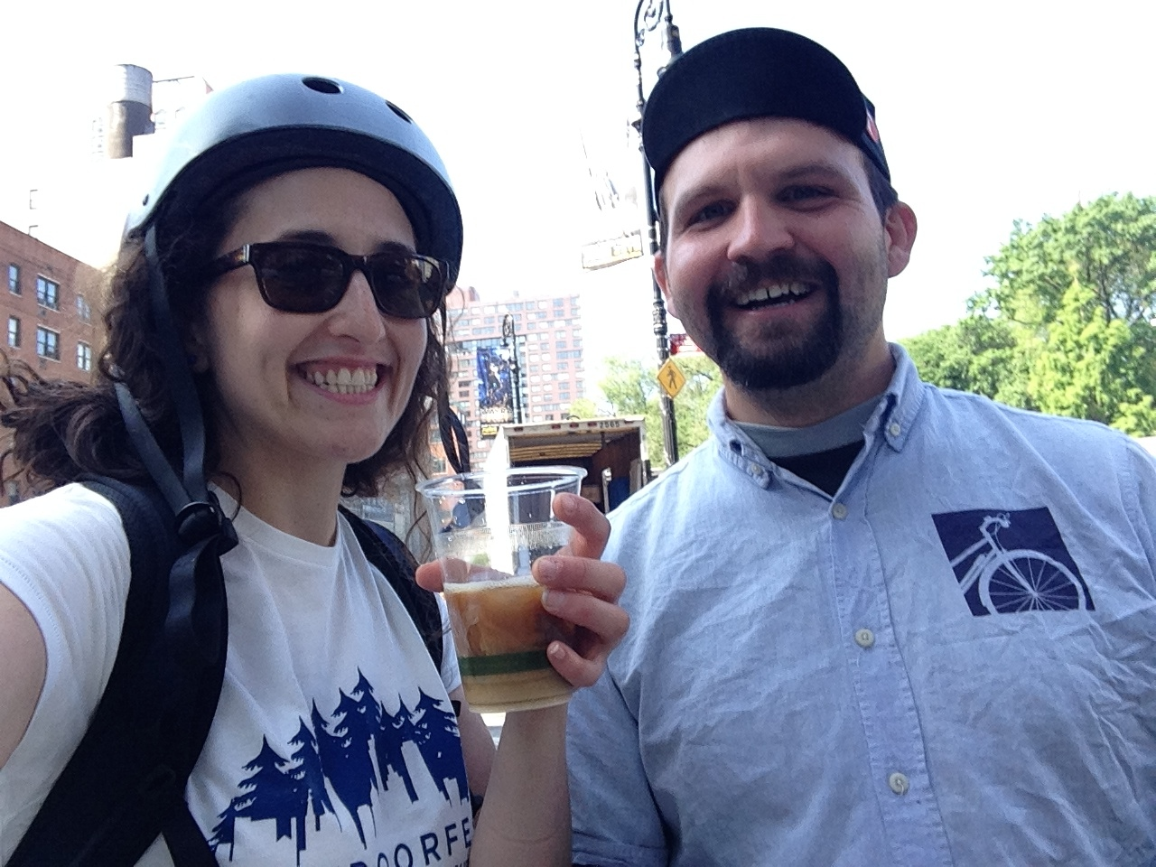 OutdoorFest's Sarah Knapp drinks some fresh ice coffee with the Union Square Transportation Alternatives team.
