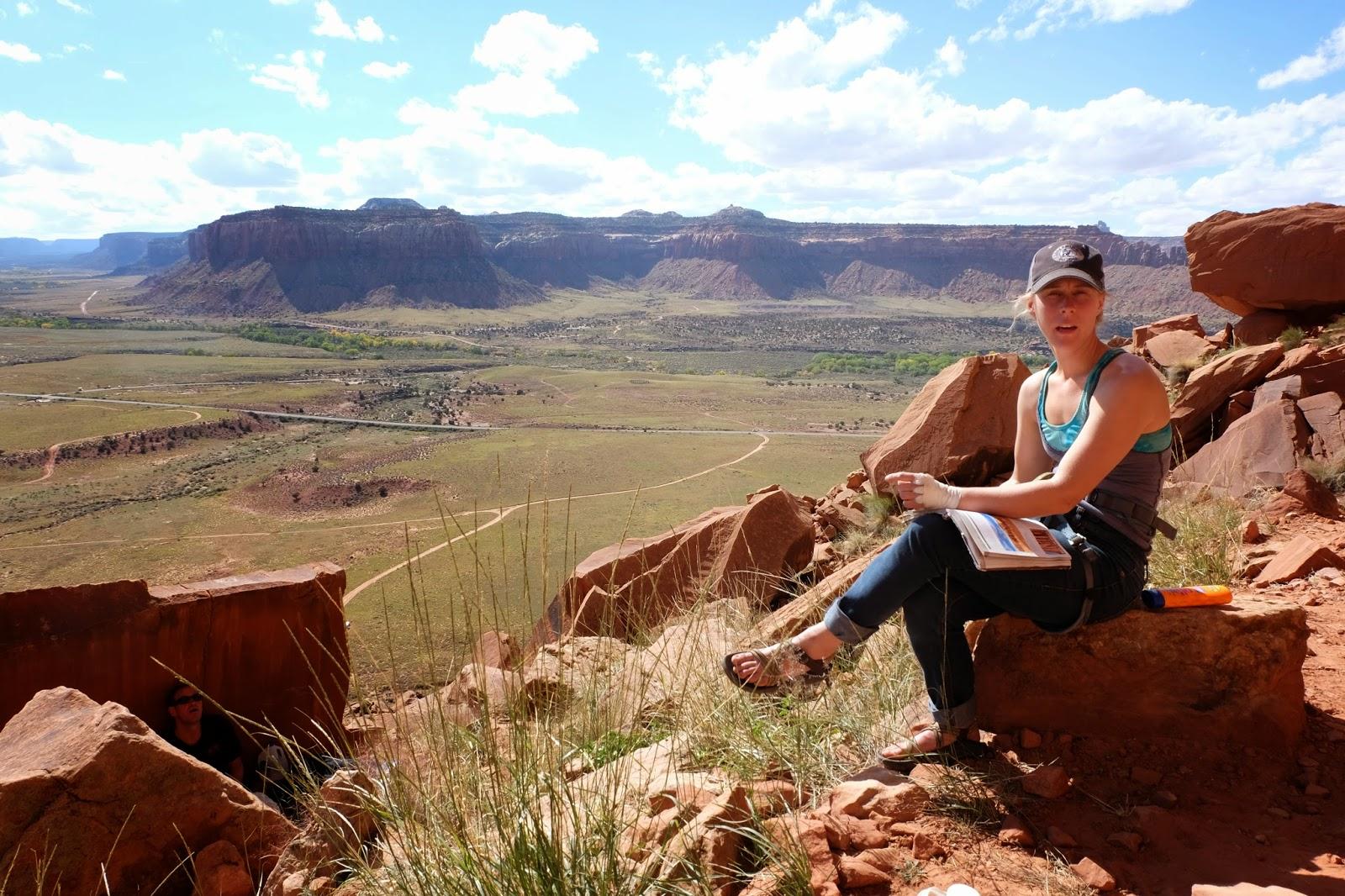 Laura Stade + guidebook,  Indian Creek Utah Fall 2013.