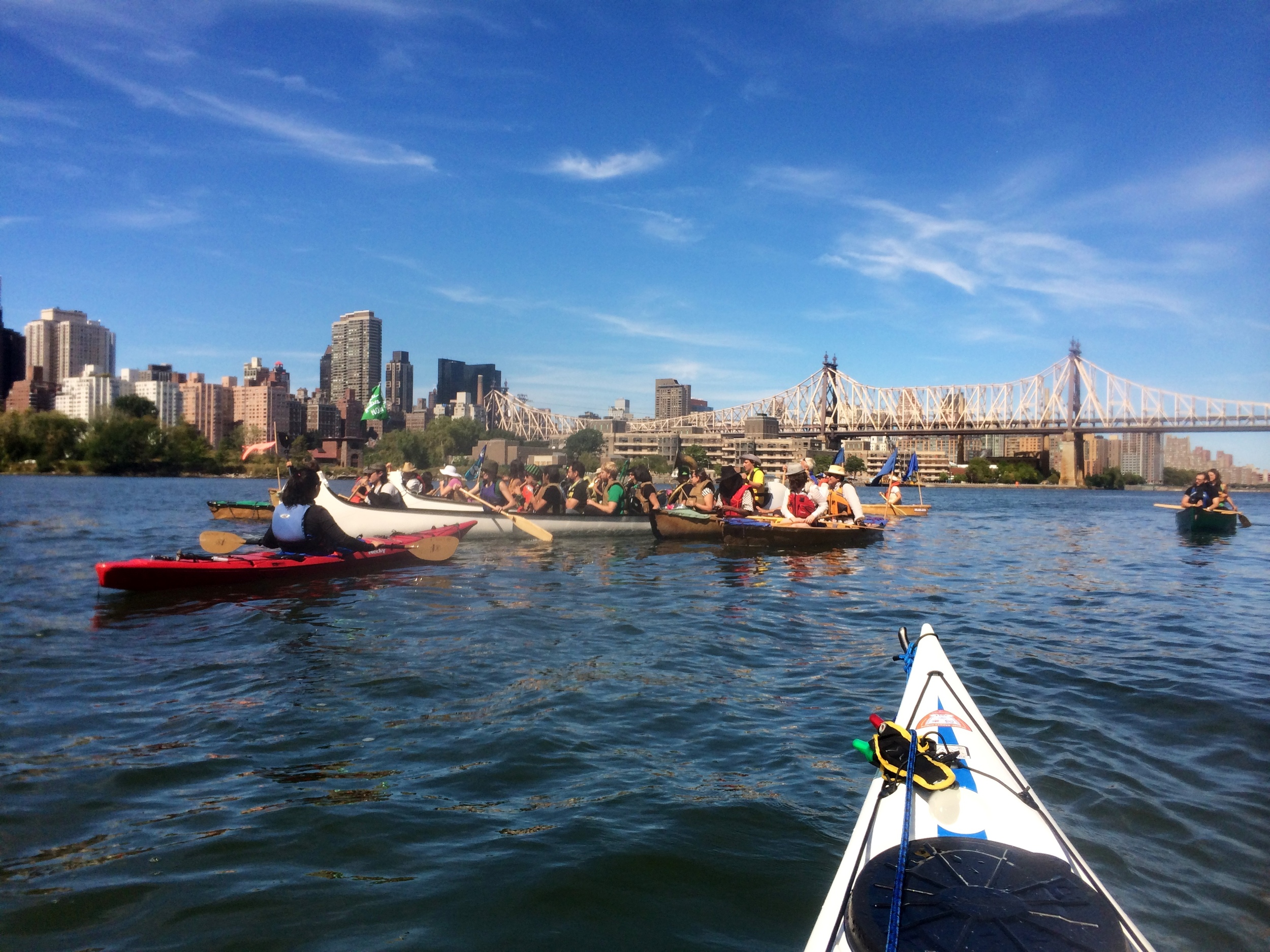 The Rude Mechanical Orchestra plays on canoes in the East River - photo by Stephen Wong