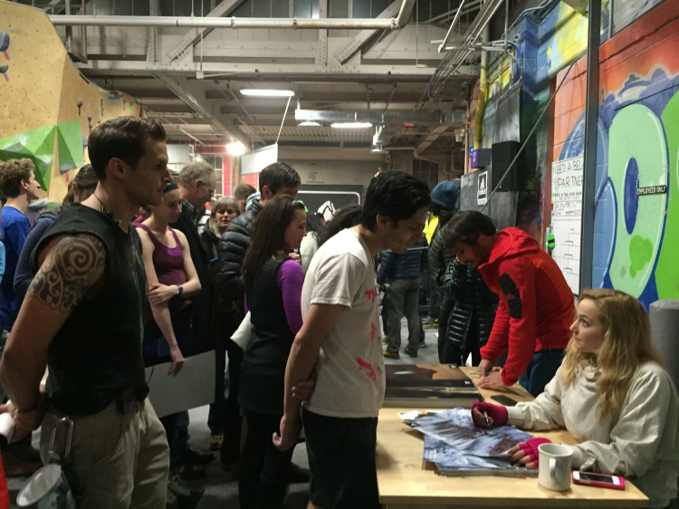 Sasha DiGiulian and   Kevin Jorgeson sign posters for fans