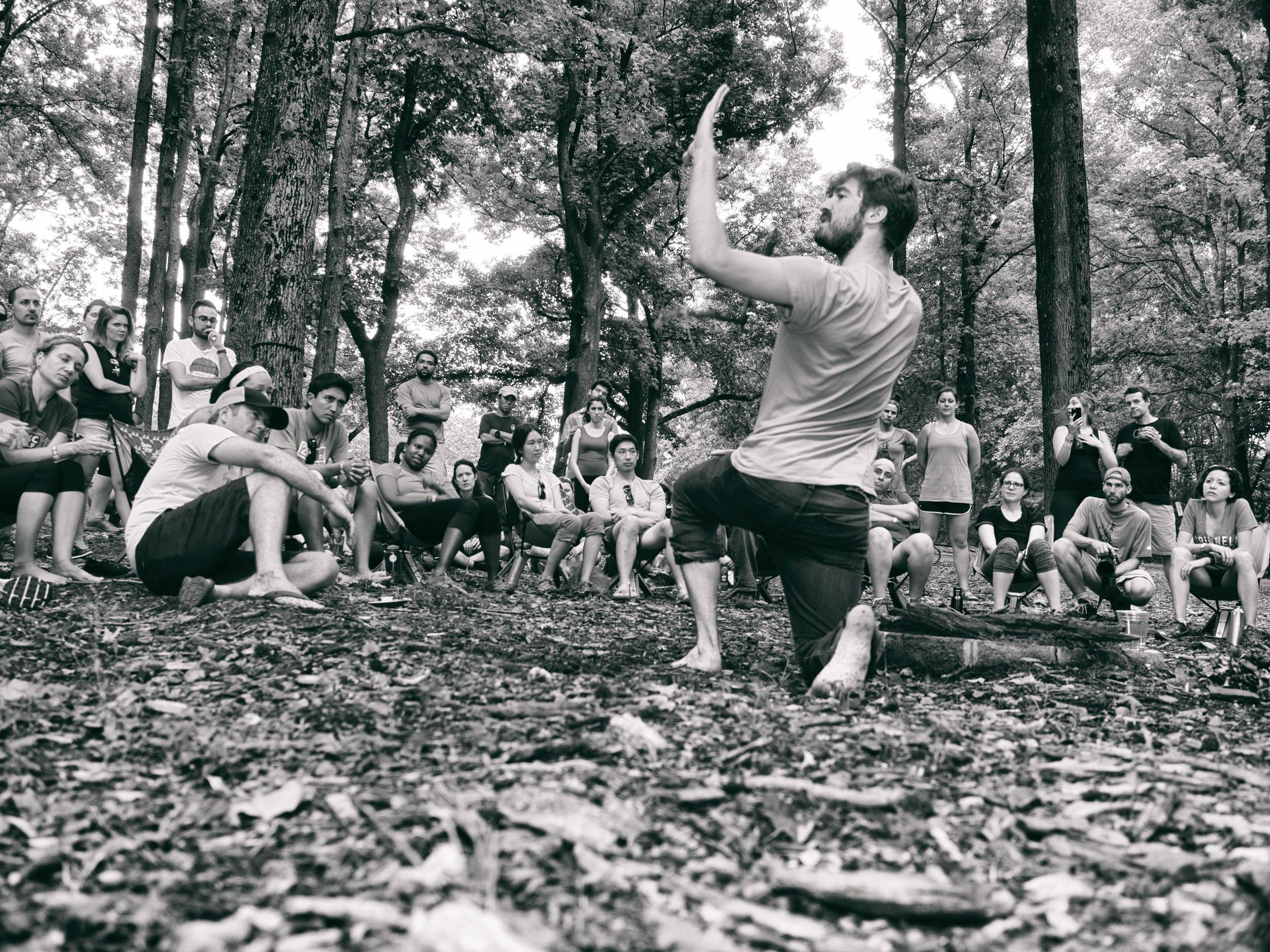 Rhett Godfrey teaches his fire by friction class. Photo by Tom O'Hare.