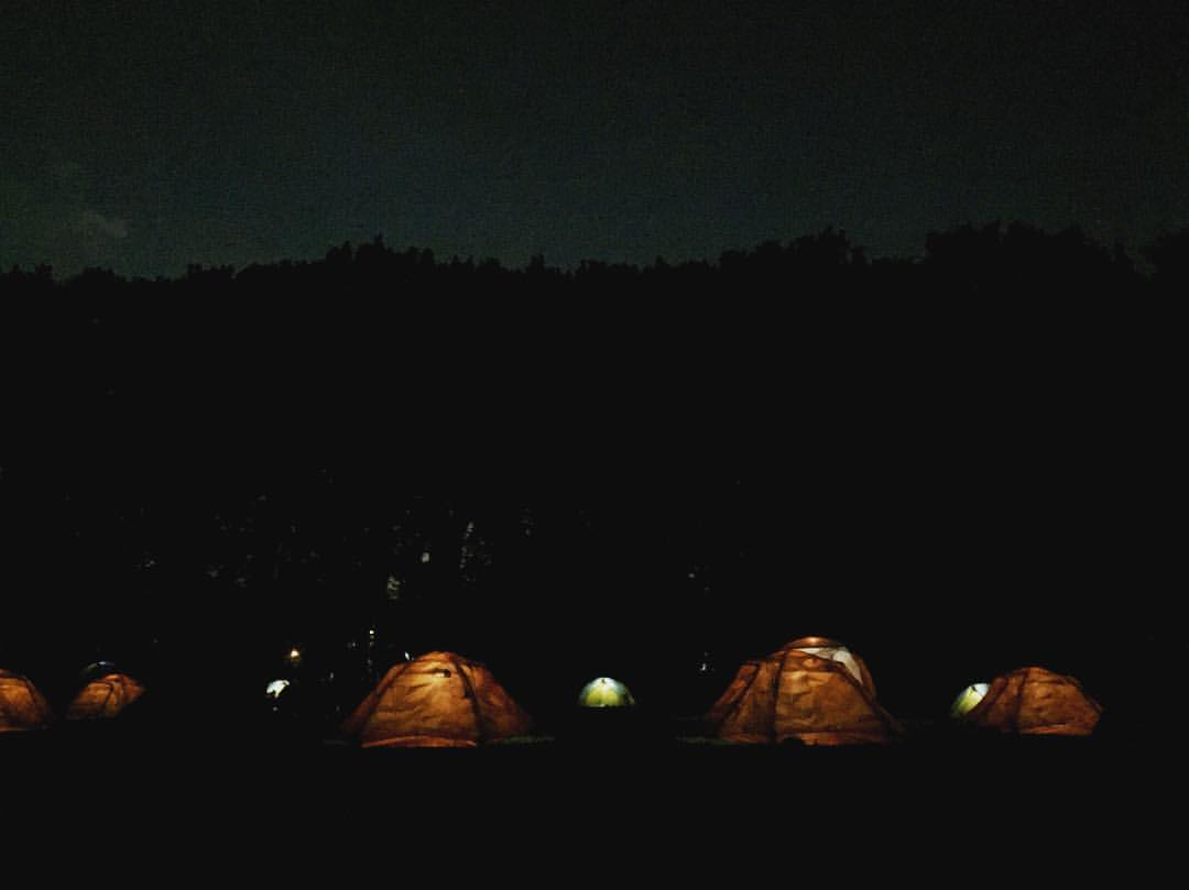 The North Face VIPeak  Camping Area lit up for the night.