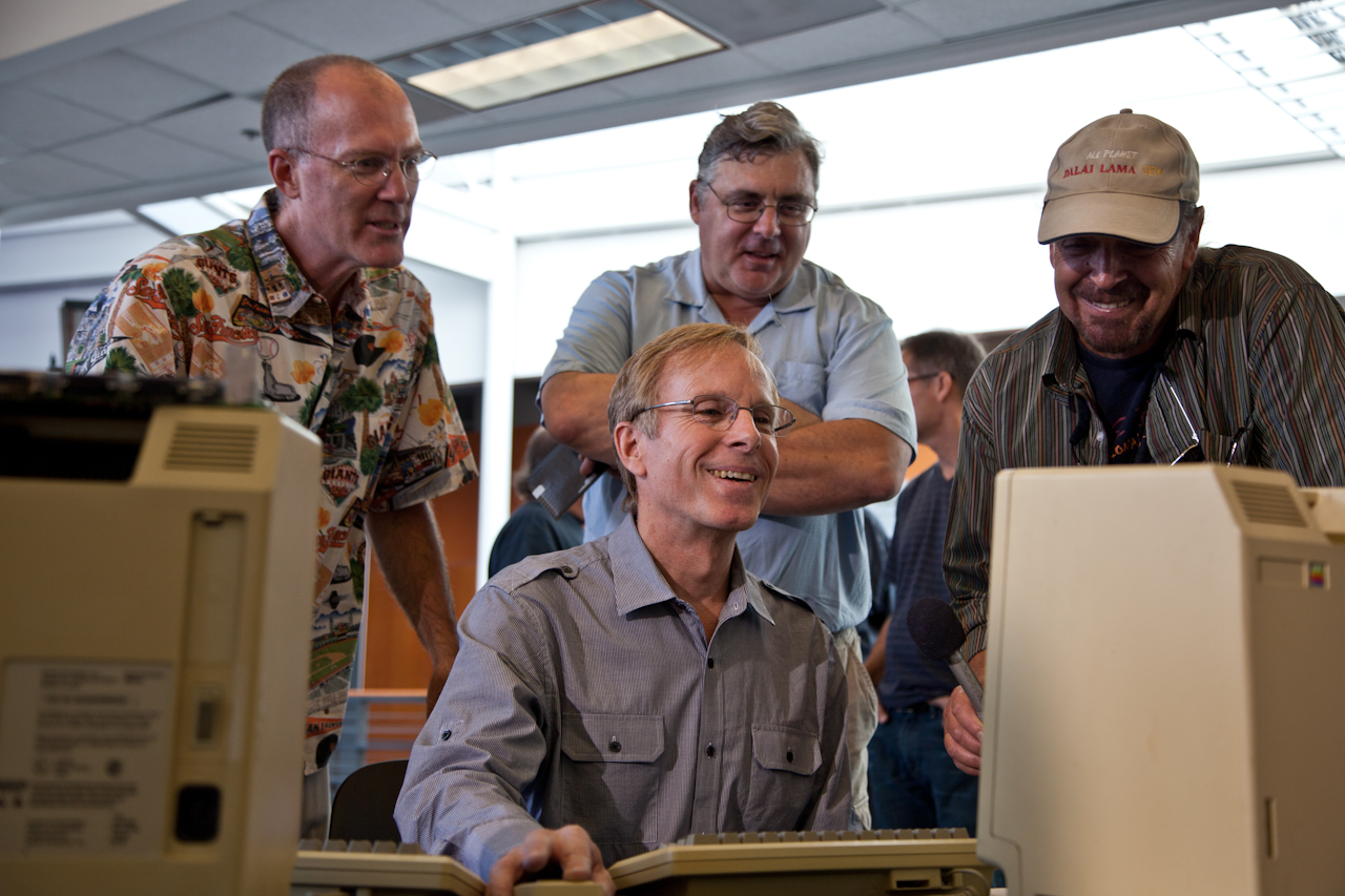 The Original MacWrite Team - Creator Randy Wigginton running the computer, with Ed Ruder (left) and Don Breuner (Center rear) looking on.