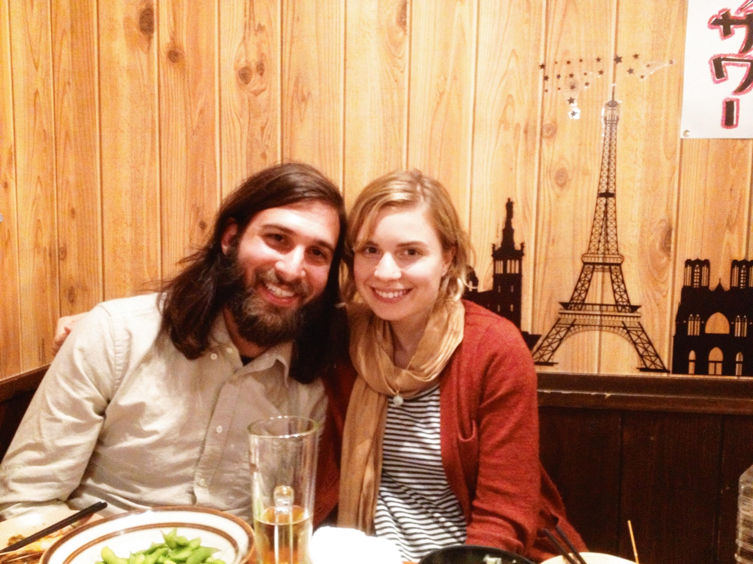 Happy couple at an Izakaya with Carlos & friend