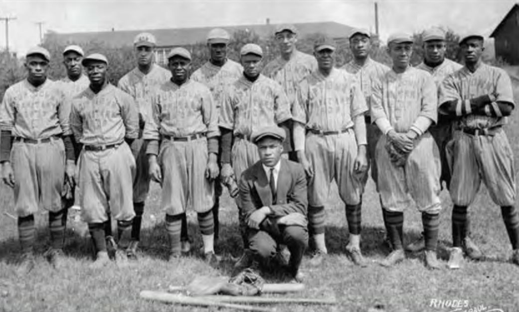 Jimmy Lee played on a number of all-black and integrated teams. Here he is with his 1923 Uptown Sanitary Shop Team: Front row (L-R): First player unidentified Dennis Ware, George White, fourth player (behind coach) unidentified, Jimmy Lee, Samuel Stephens (furthest player to the right), Back row (L-R): First player unidentified, second player unidentified, third player unidentified Bobby Marshall, John L. Davis, Louis House. Coach/Manger unidentified  Photo from Lee Family Collection, courtesy of Frank M. White.