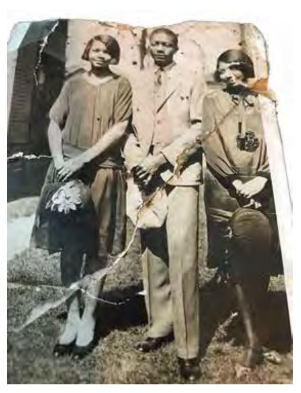 "This photo was saved by Rondo community members when Jimmy's family home went up for sale in 2016. Jimmy stands with two of his favorite ""girls;"" his wife, Jane(left_ and Jane's sister, Patty(Mitchell) Davison, who was married to one of Jimmy's gold partners Bert Davison. Photo from Lee Family Collection, courtesy of Frank M. White."