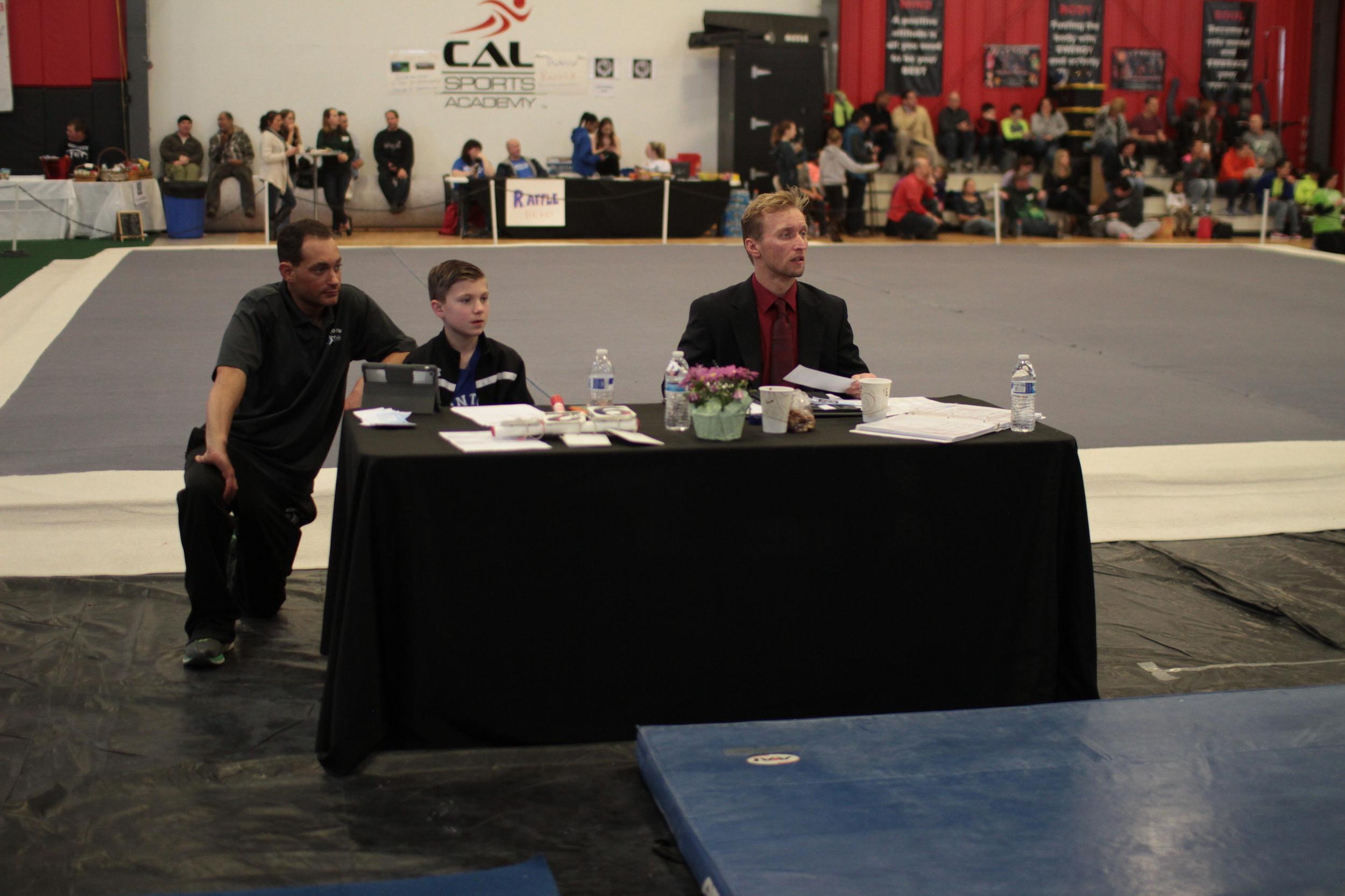 Brad Matty watch as Scott judges.JPG