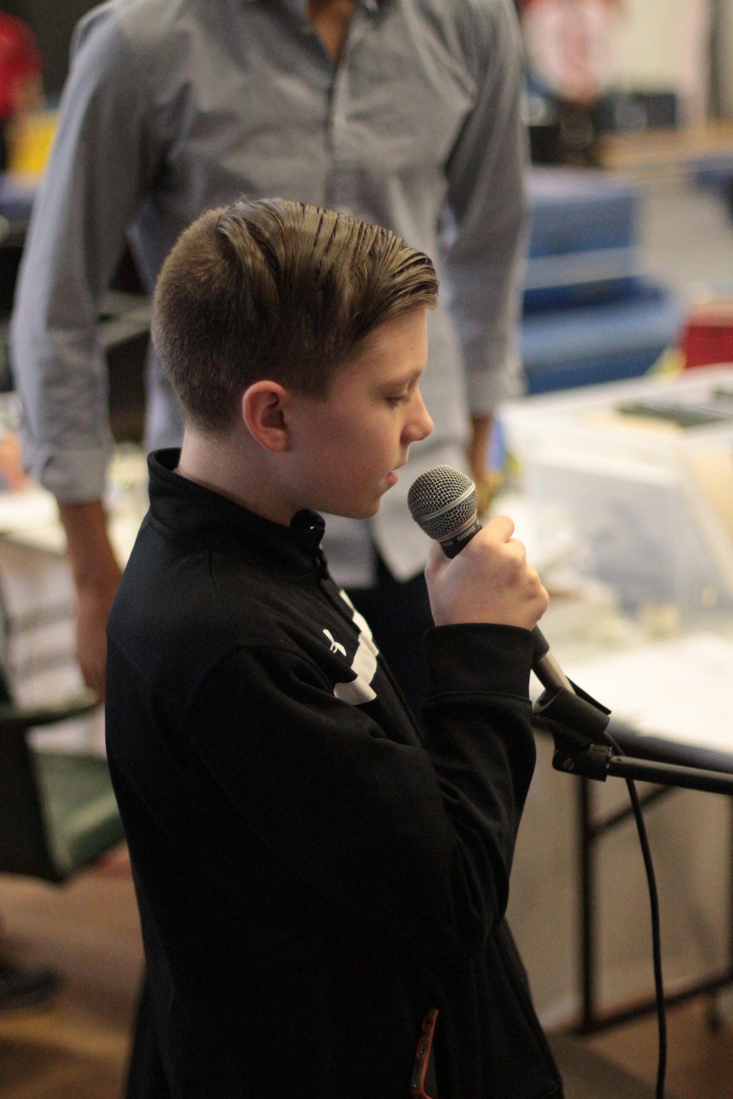 Matty singing national anthem.JPG