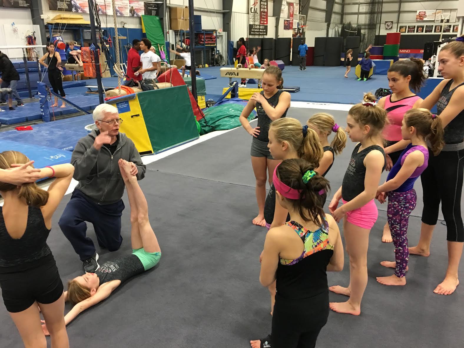 Joe Strank teaching girls team.png