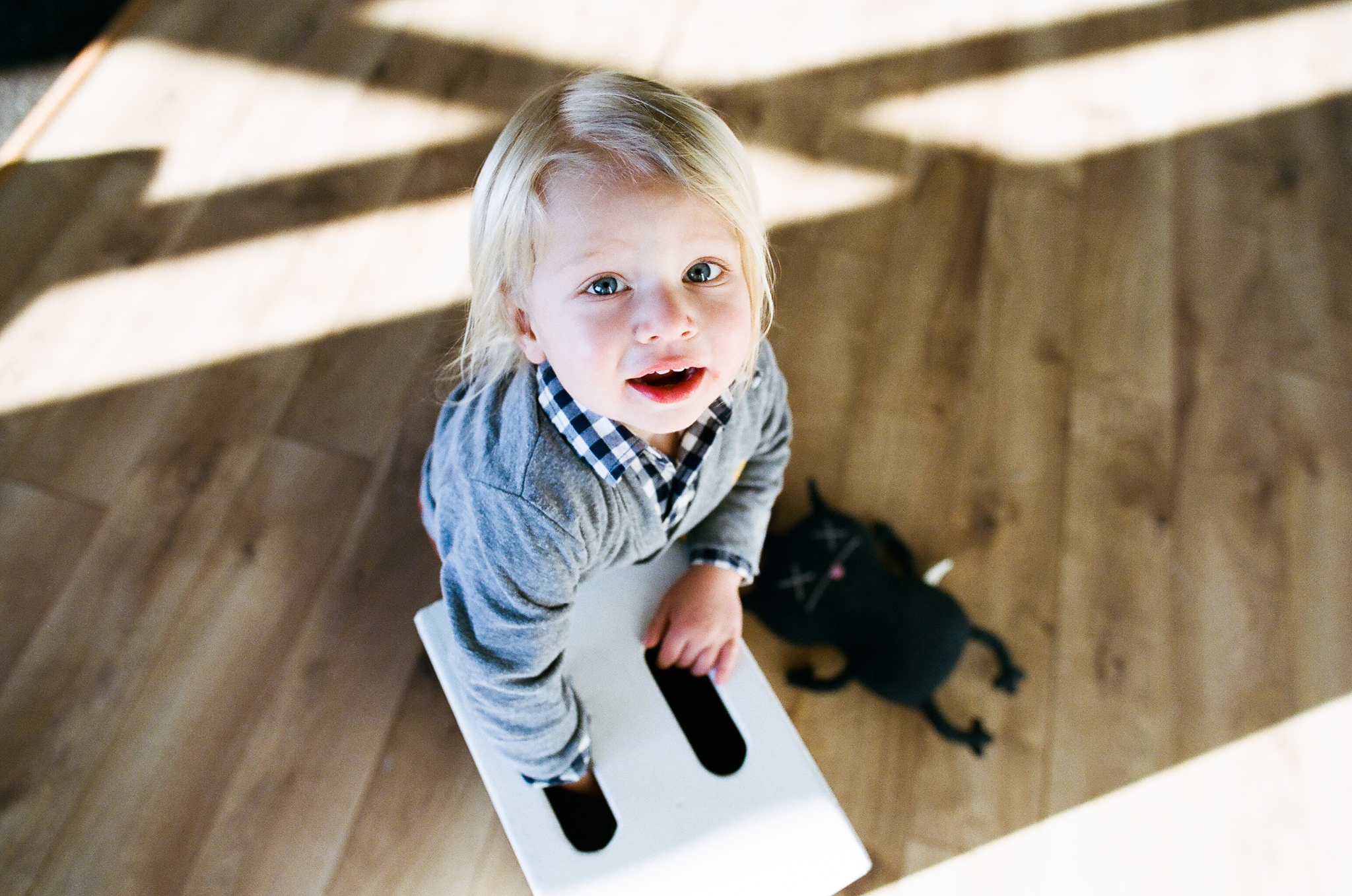 Child trying to lift an apple box