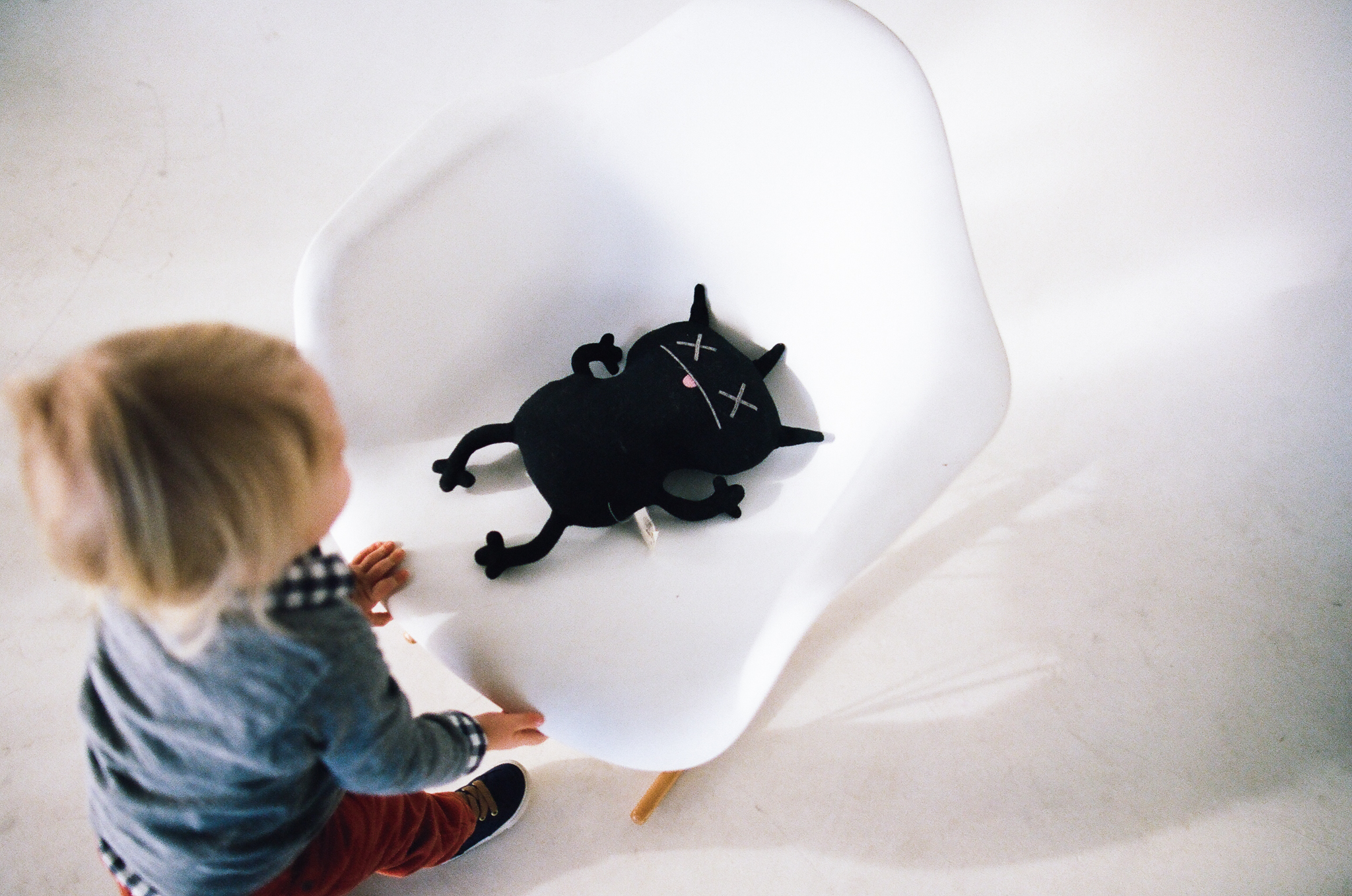 Child and monster doll in a Minneapolis photo studio