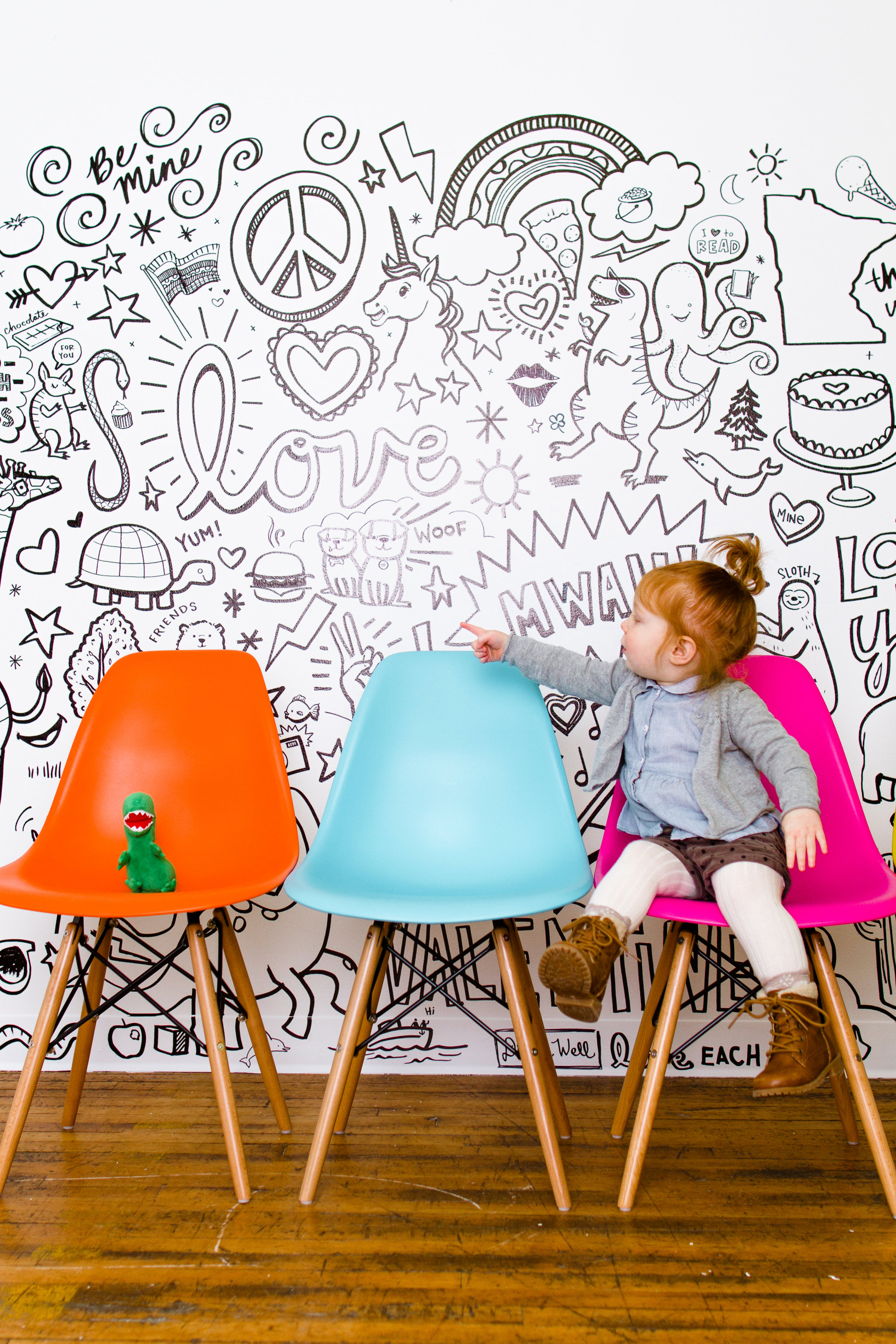 Colored shell chairs in a modern portrait studio