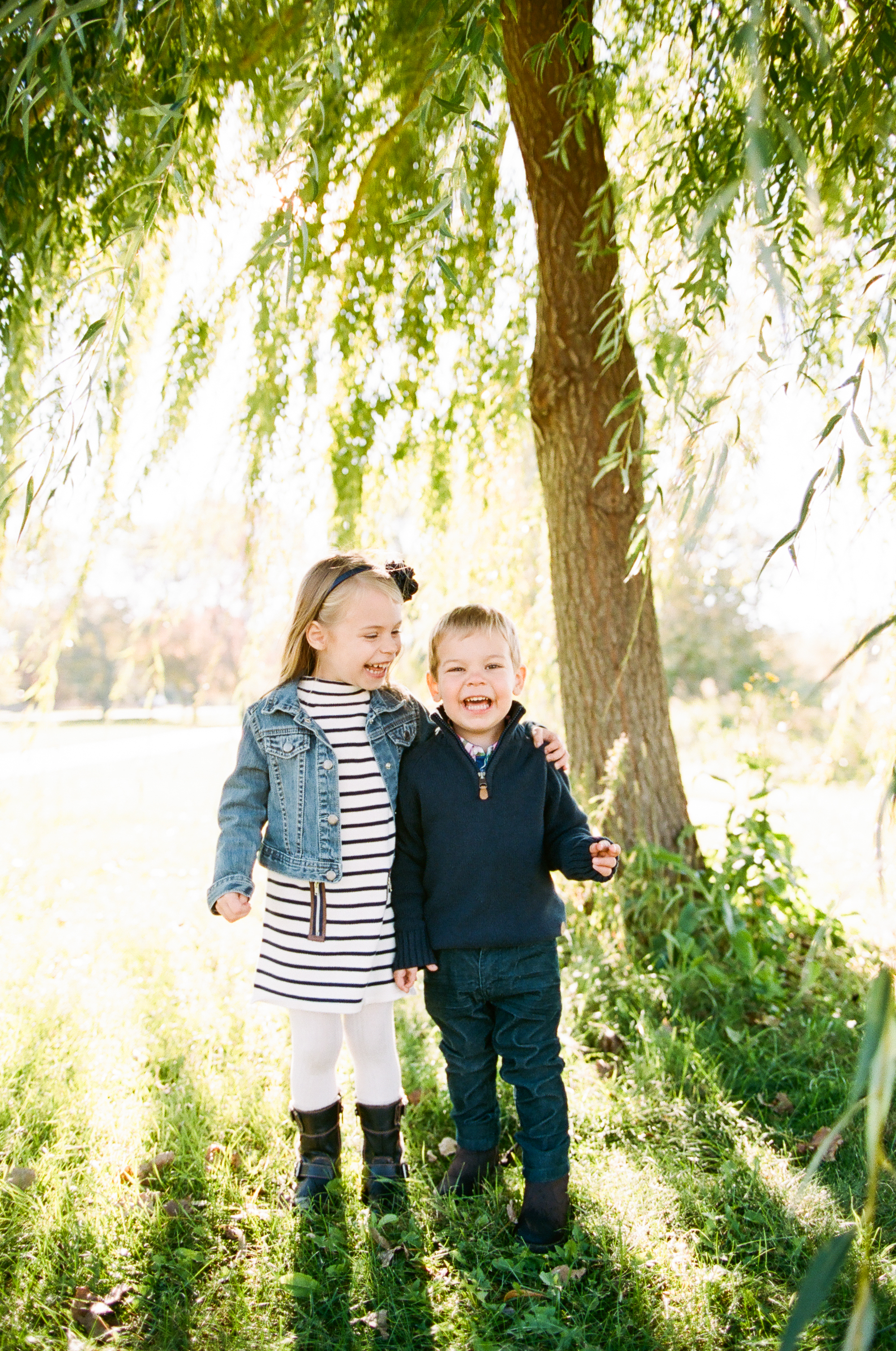 Siblings under a Willow Tree in Minneapolis, Minnesota photographed on 35mm film