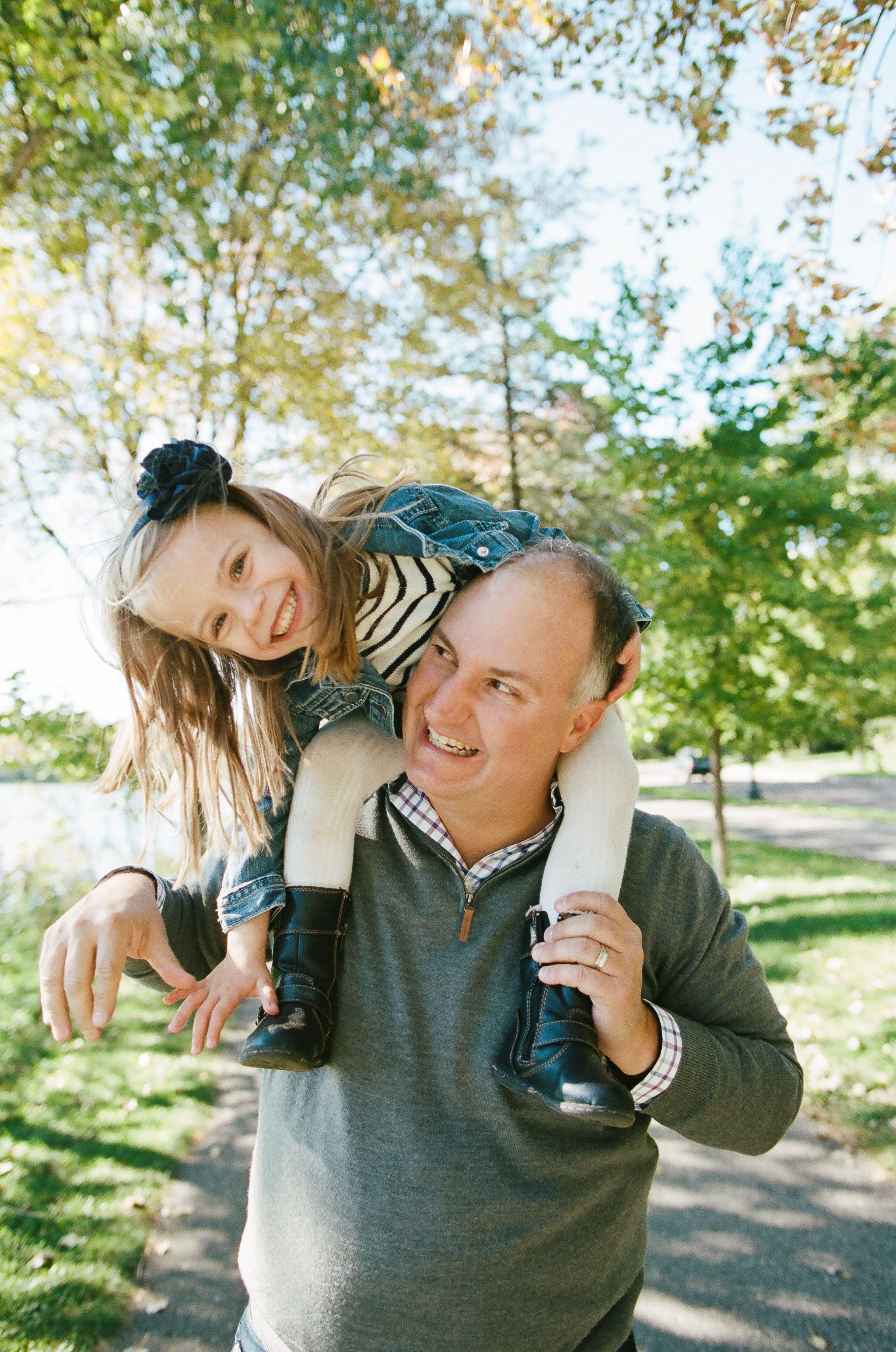 Daughter on Father's Shoulders in Minneapolis, Minnesota