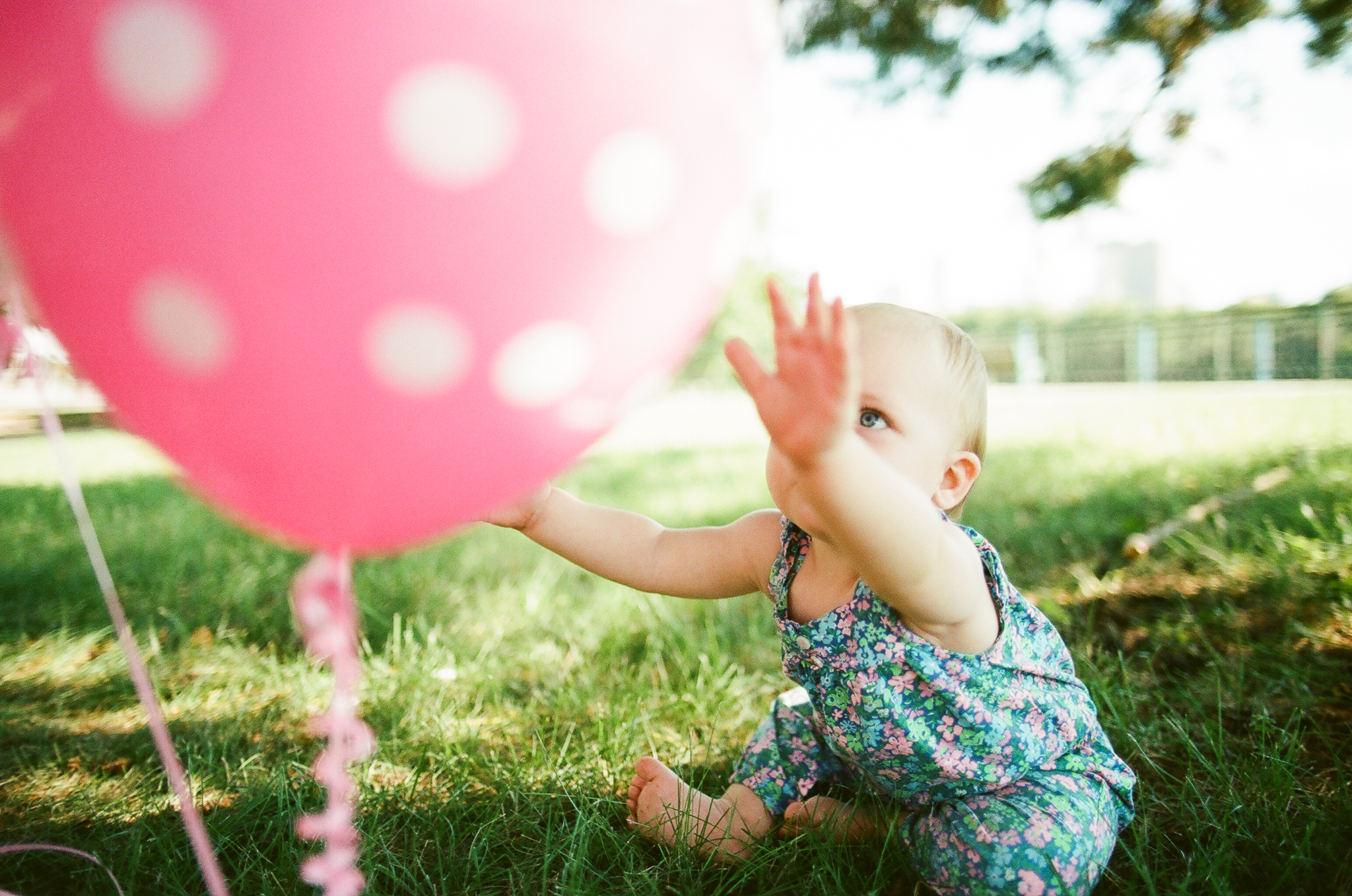 Child with Balloons on her first birthday