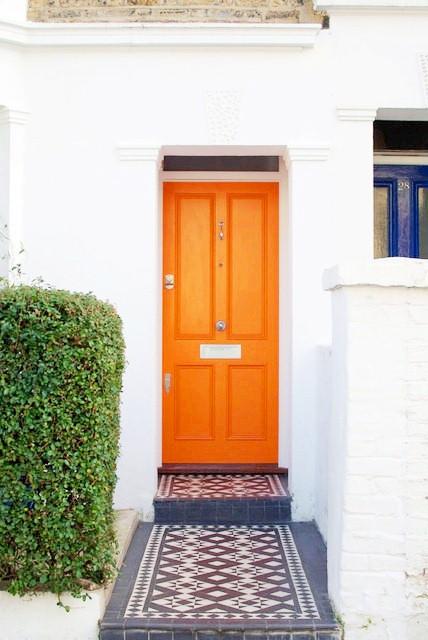 cococozy apartment therapy orange front door.jpg