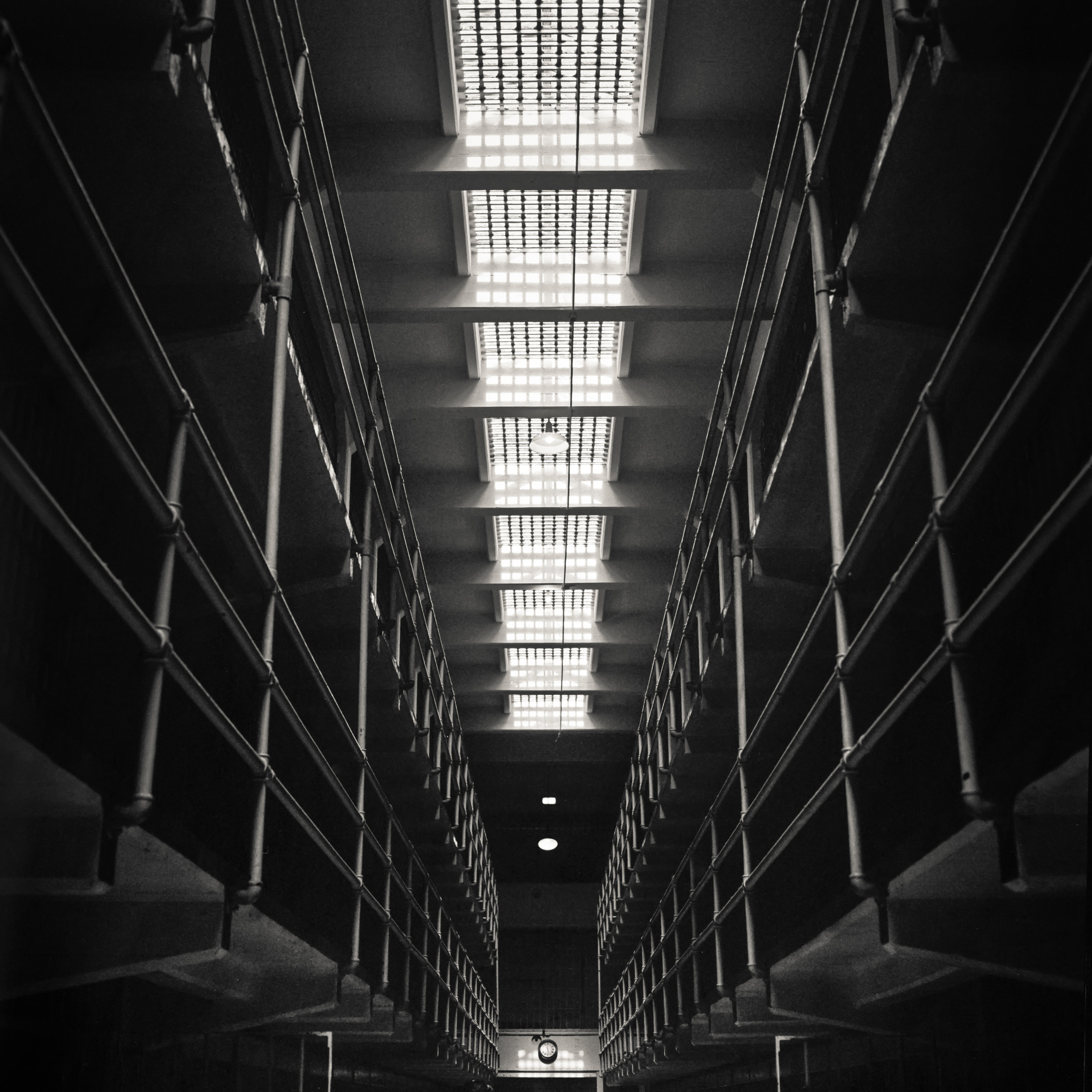 Alcatraz black white jail cell corridor dark ominous haunted