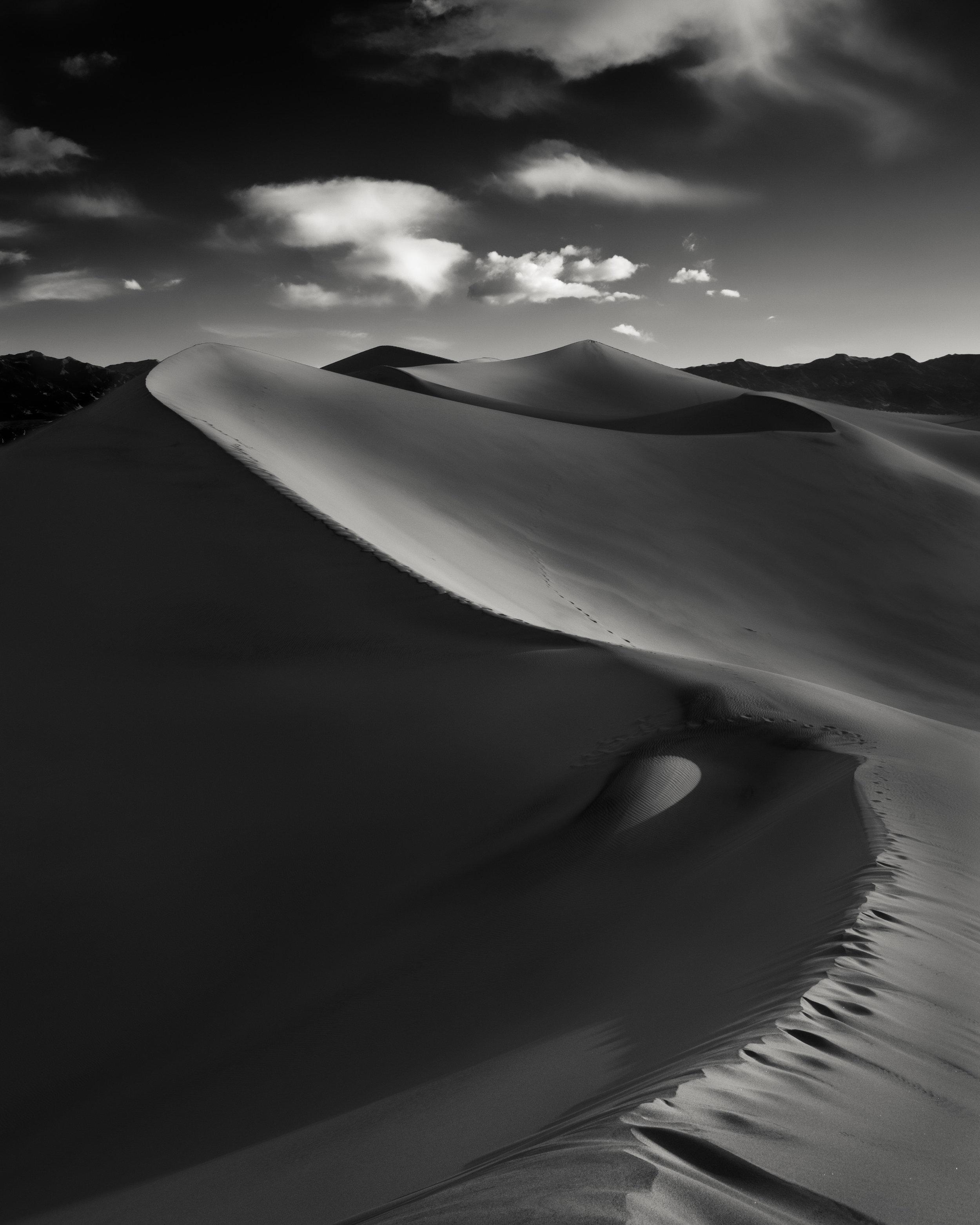 Death Valley black white sand dunes curve ridge serpentine