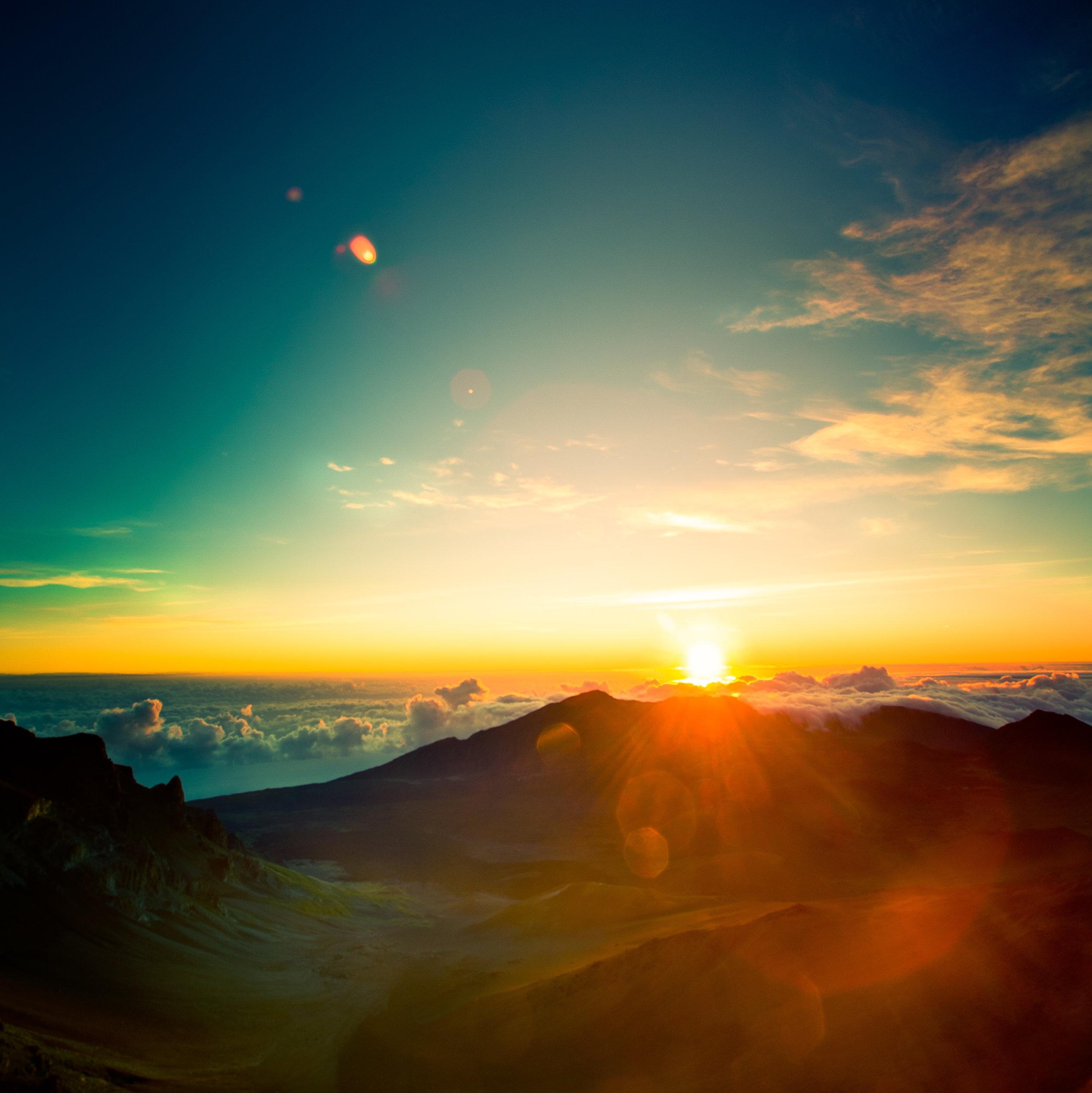 Maui Haleakakla sunrise clouds house sun flare joy wonder
