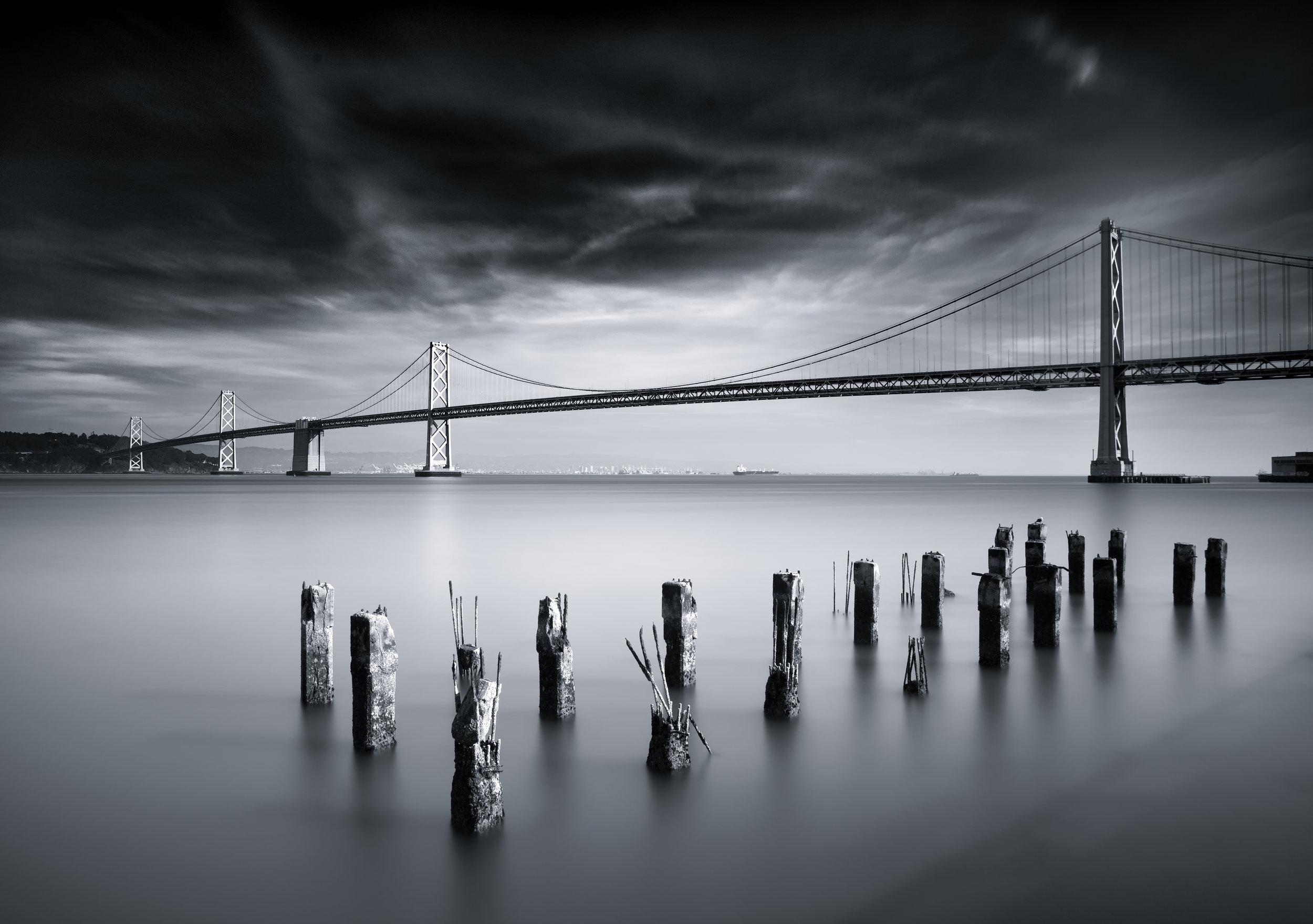 San Francisco black white bay bridge pier pilings