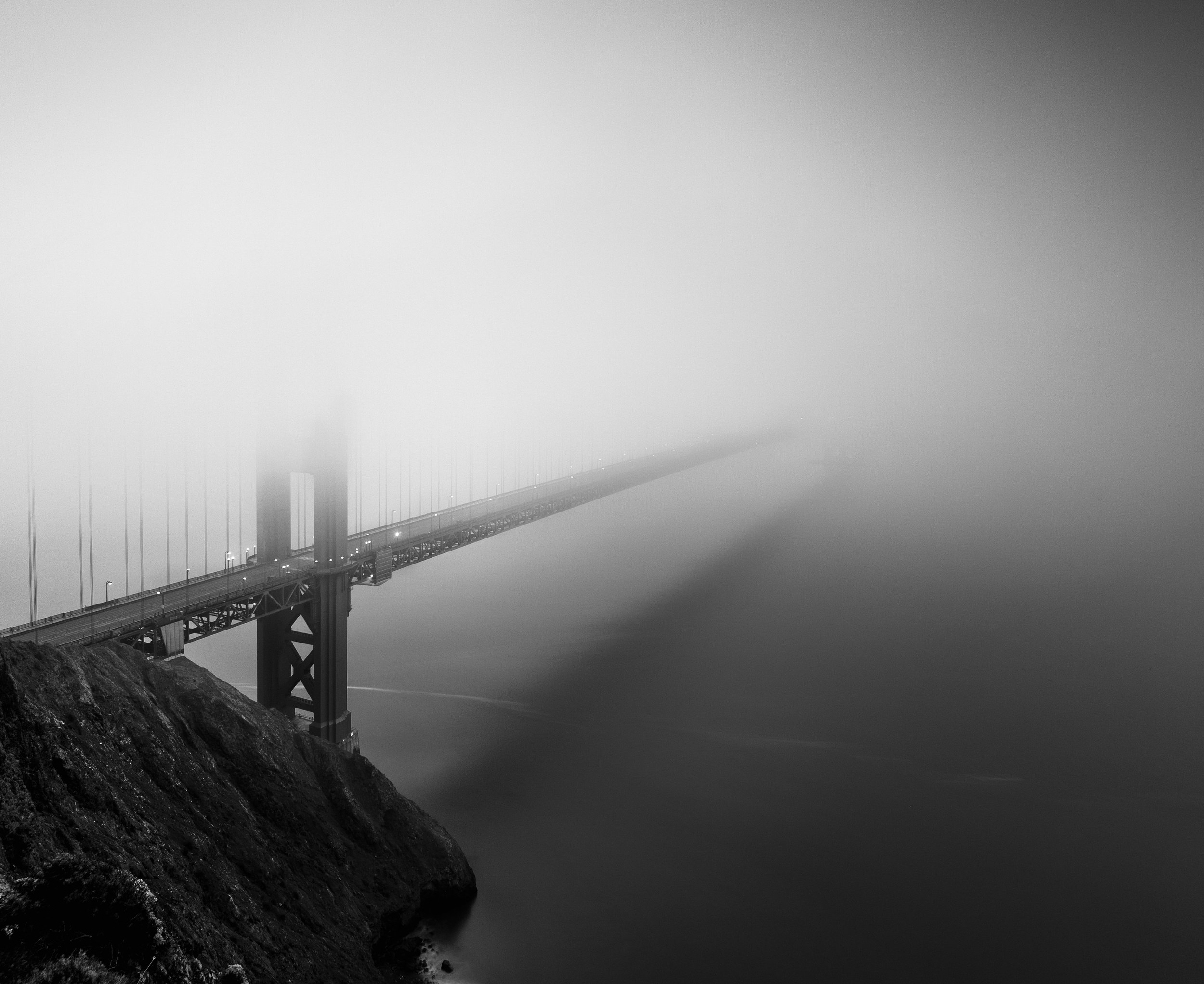 Sausalito black white golden gate bridge fog suspended
