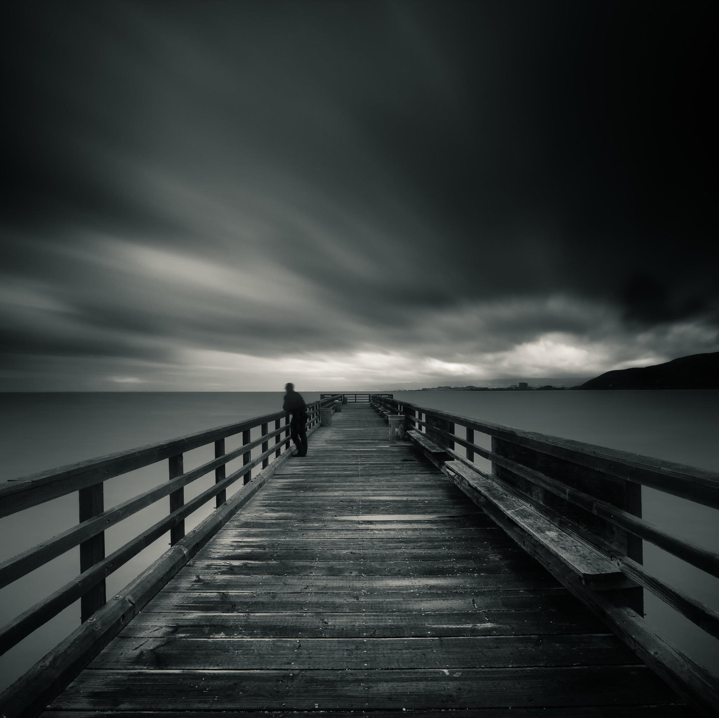South San Francisco black white candlestick pier lone figure storm clouds